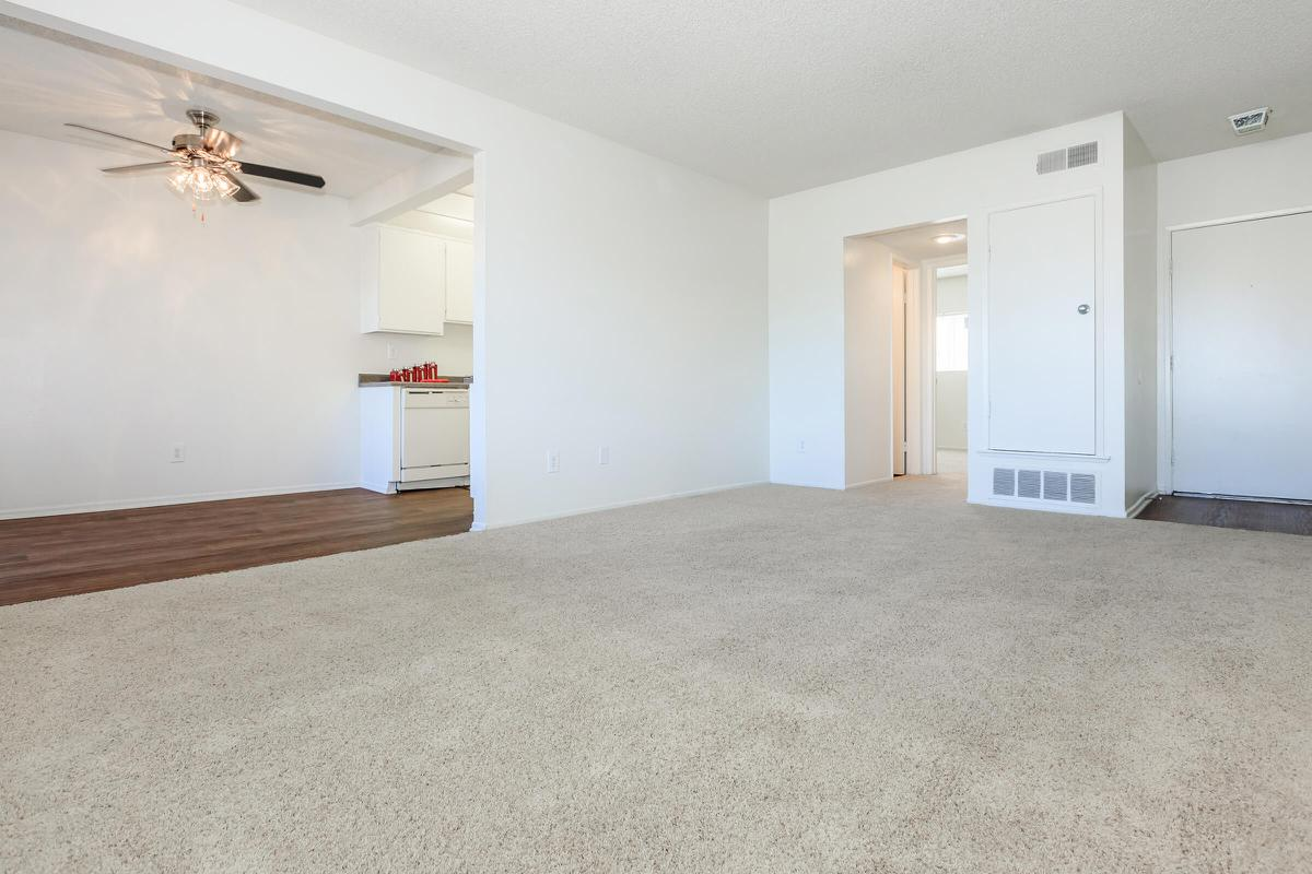 Living room with carpet and dining room with wooden floors