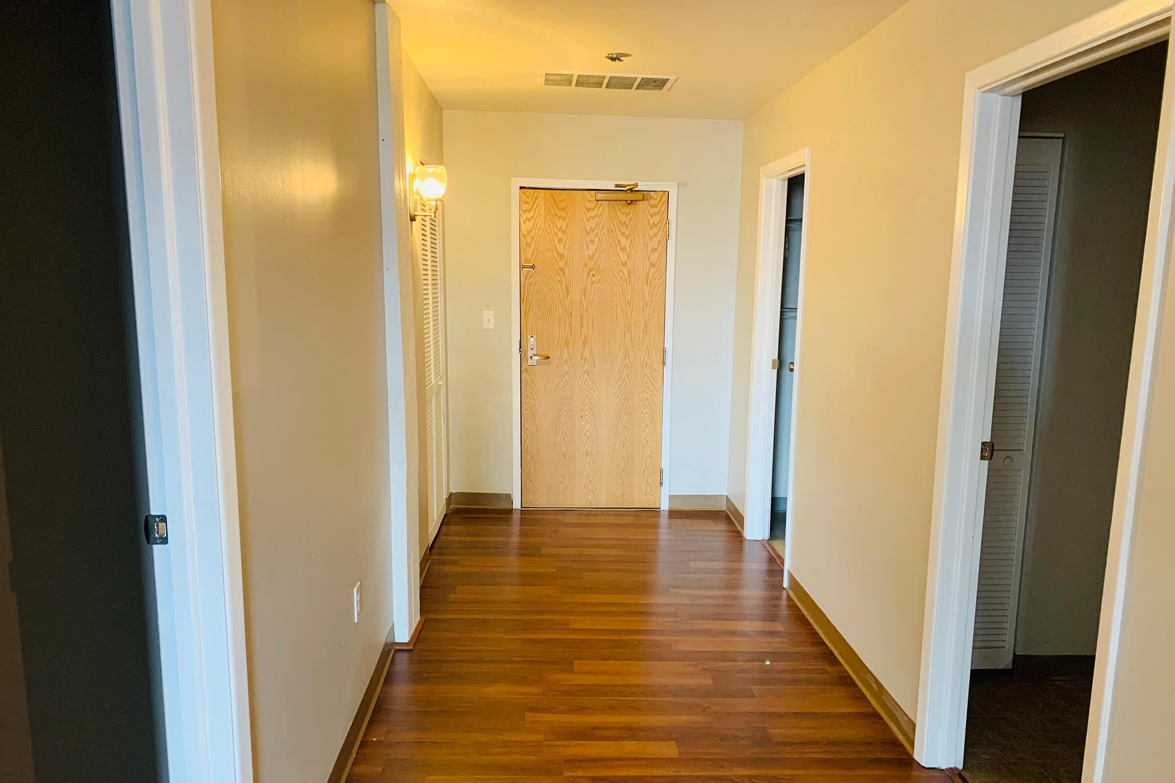 a wood door in a room