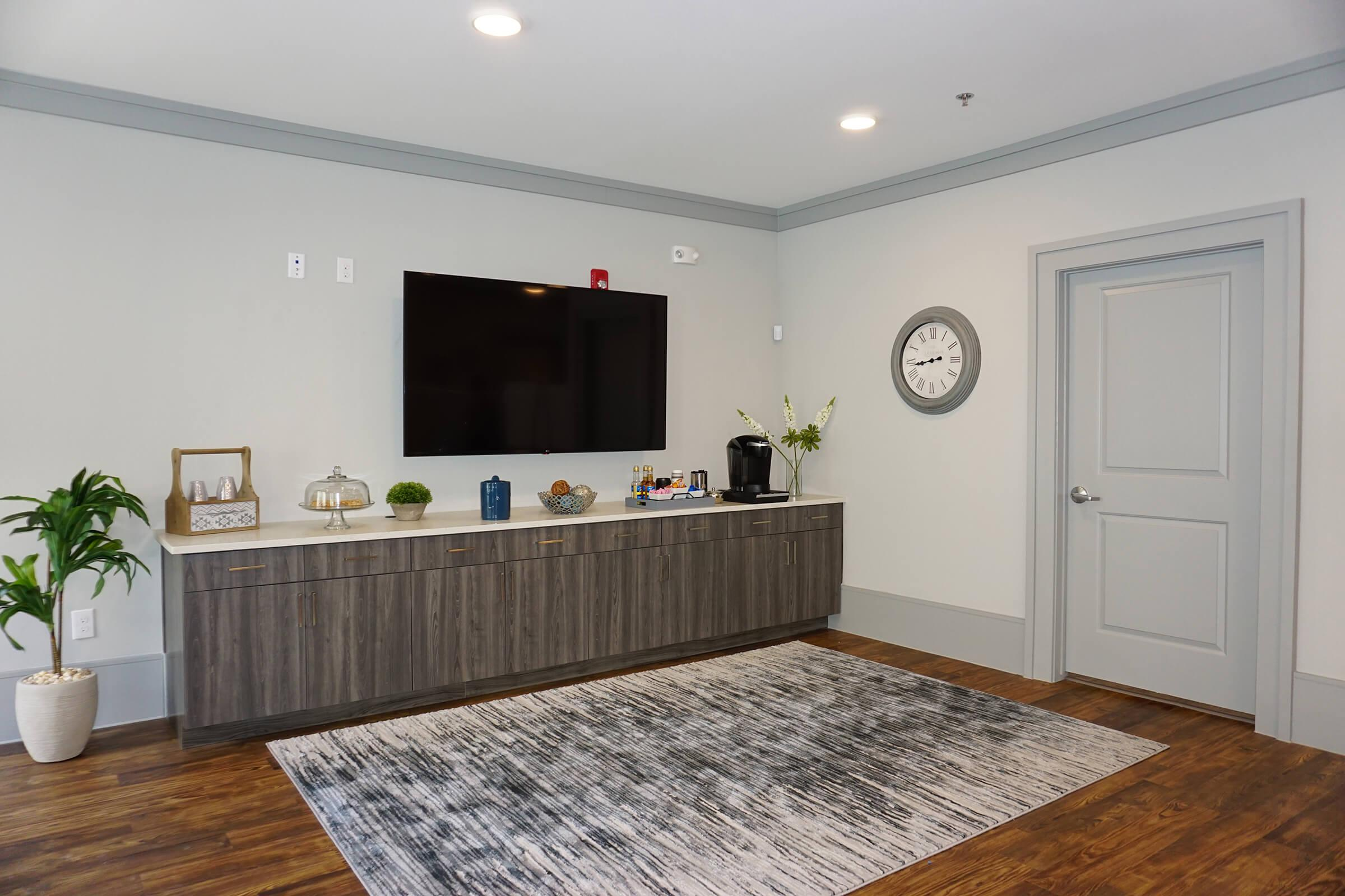 a room filled with furniture and a flat screen tv