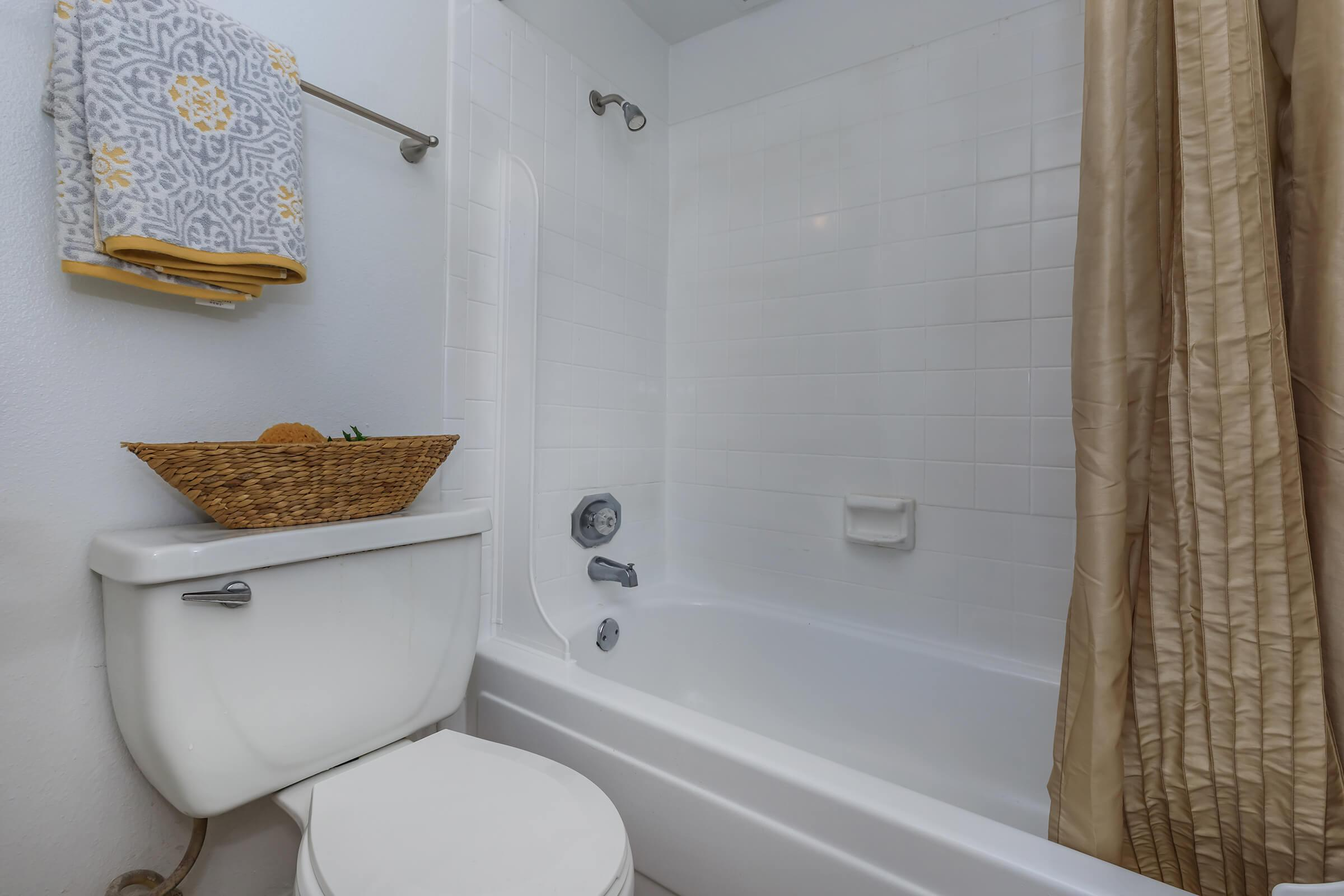 a shower curtain next to a tub