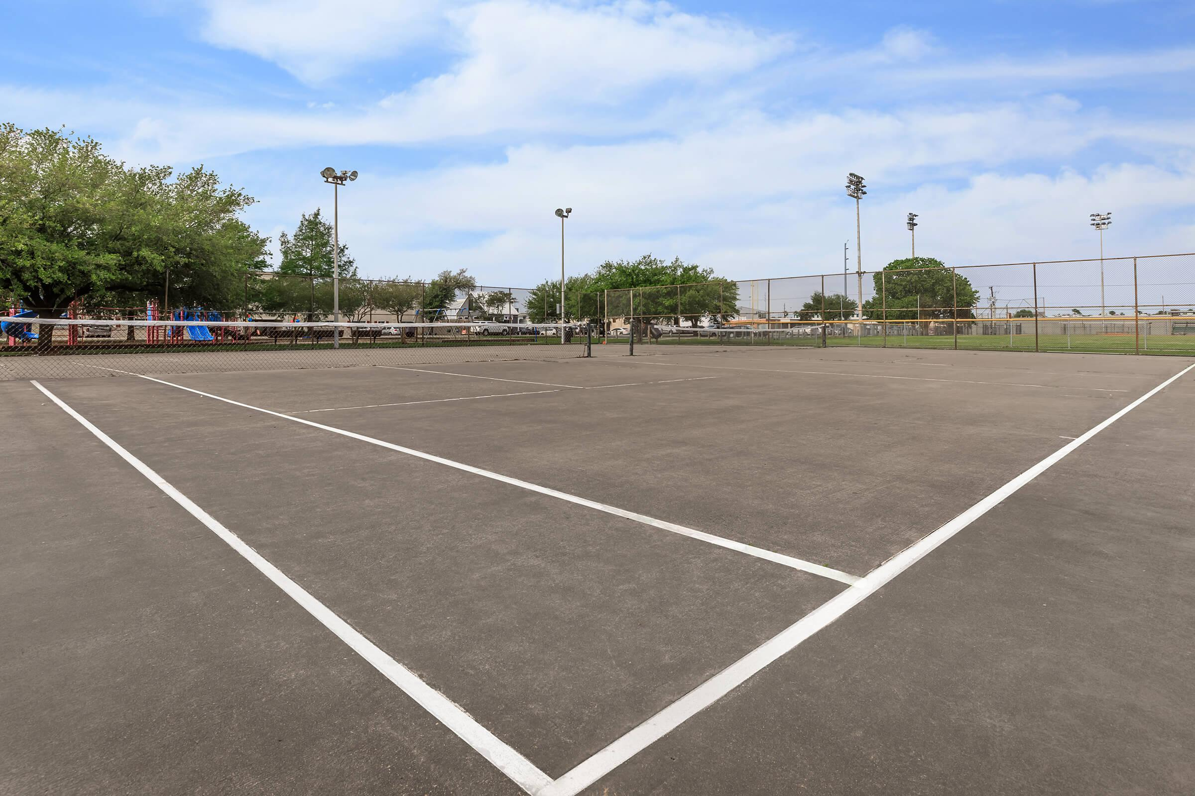 a basketball court in the middle of a road