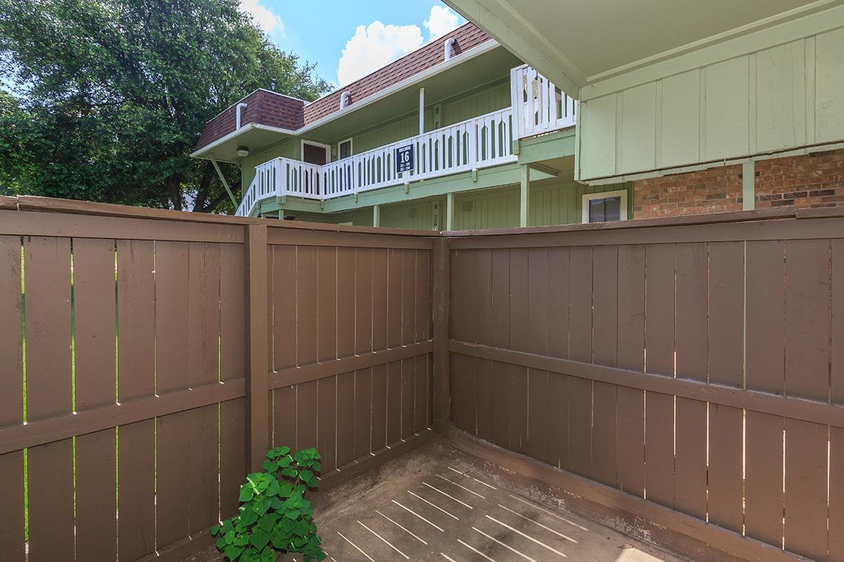 a building with a wooden fence