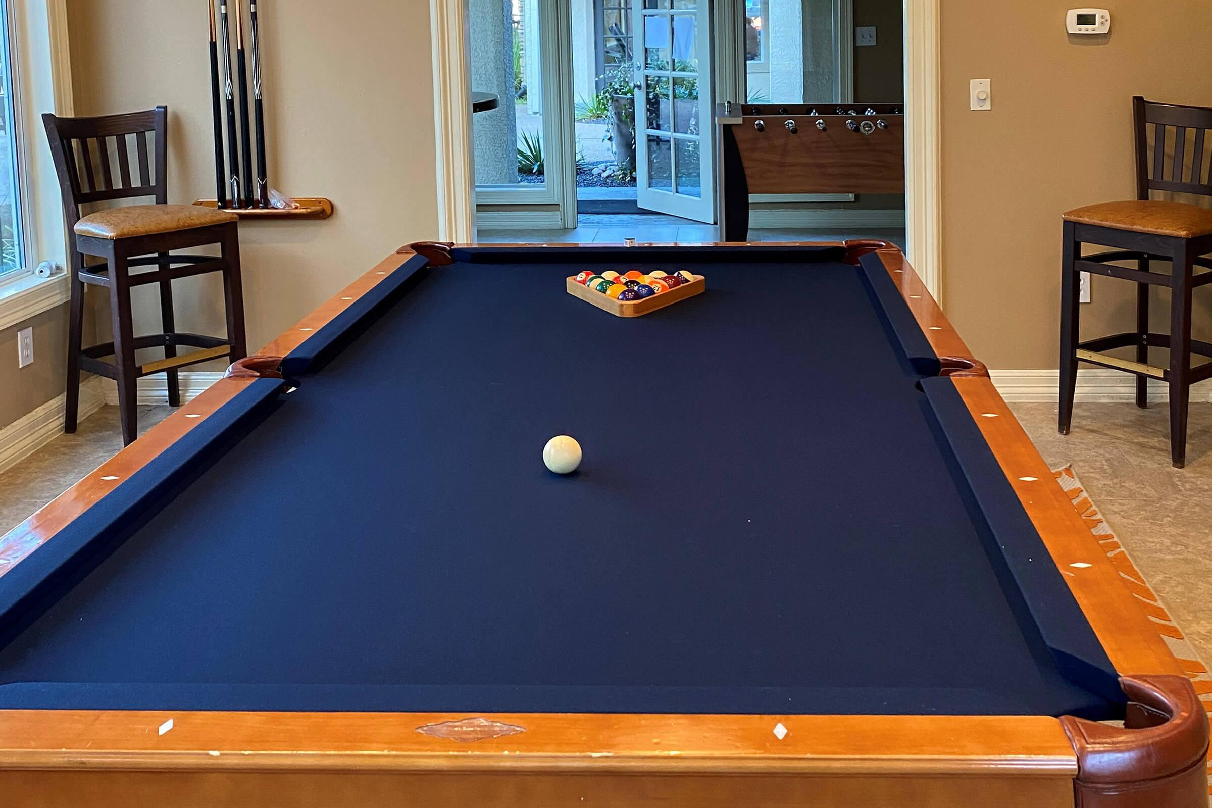 a table with a ball in a room