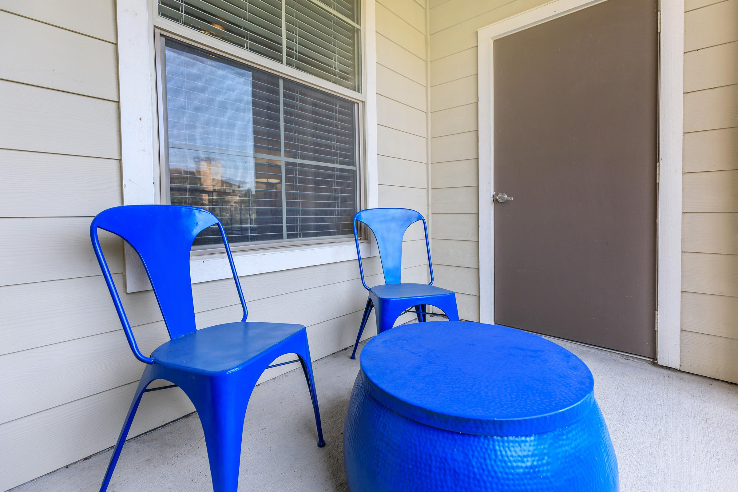 a glass with a blue chair