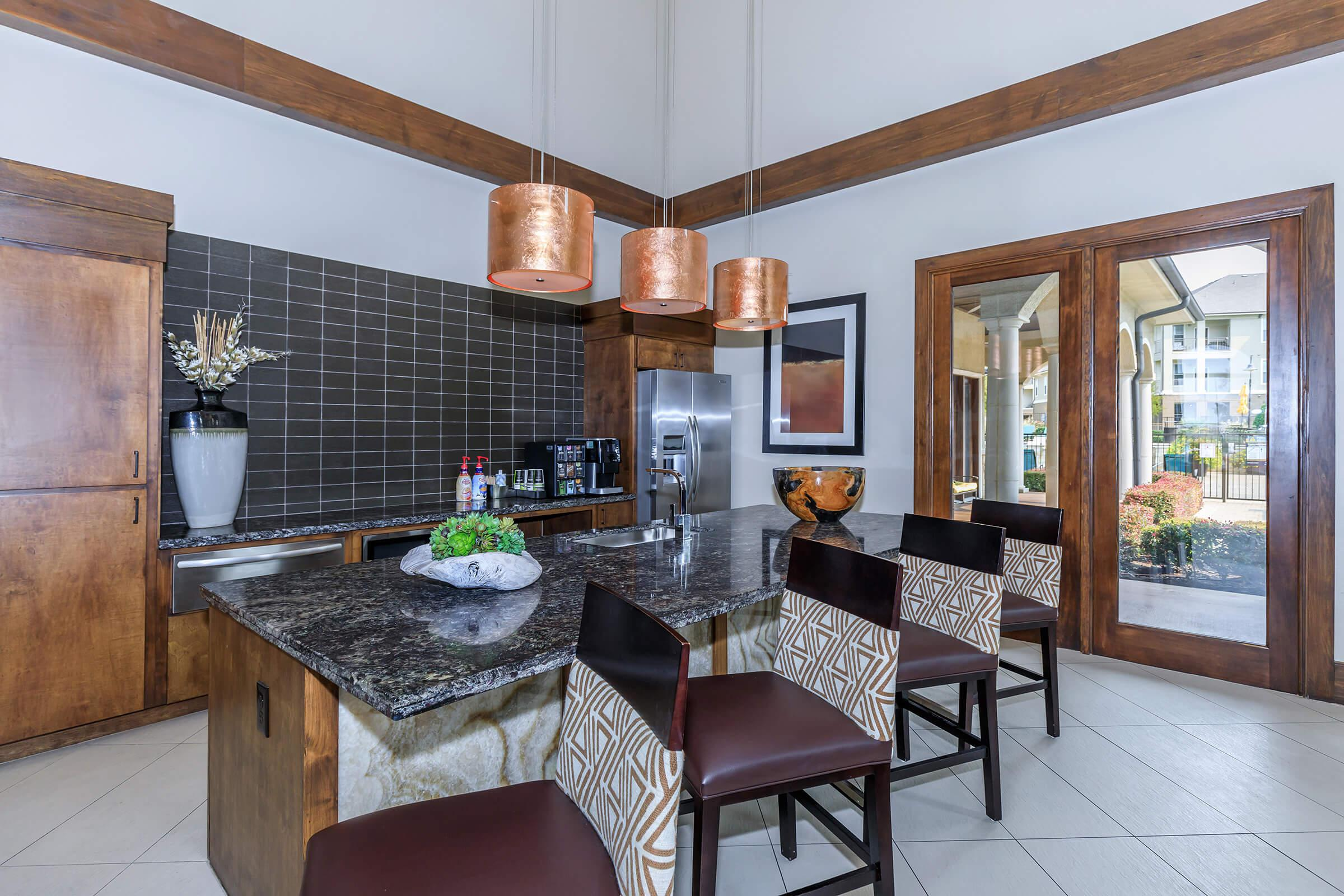 a kitchen with a dining table