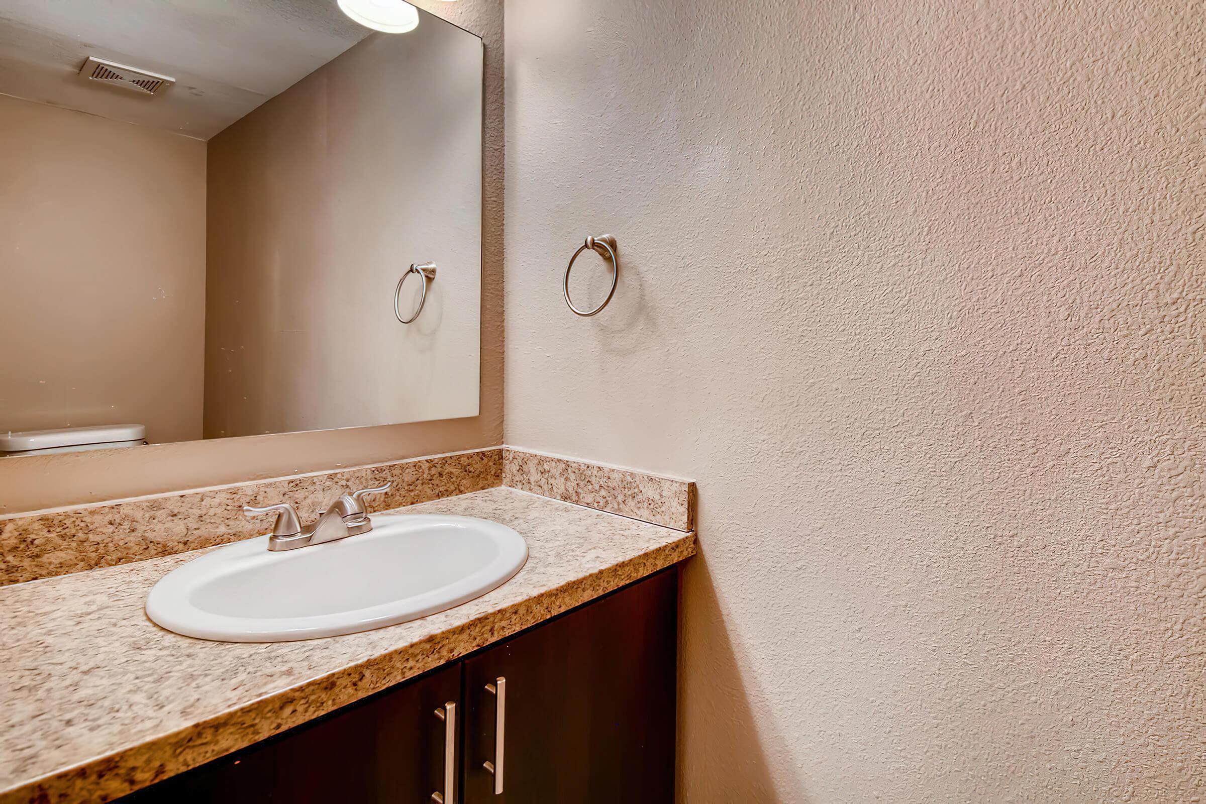 1801 E Girard Pl Unit 157-large-012-15-Downstairs Hall bathroom-1500x1000-72dpi.jpg