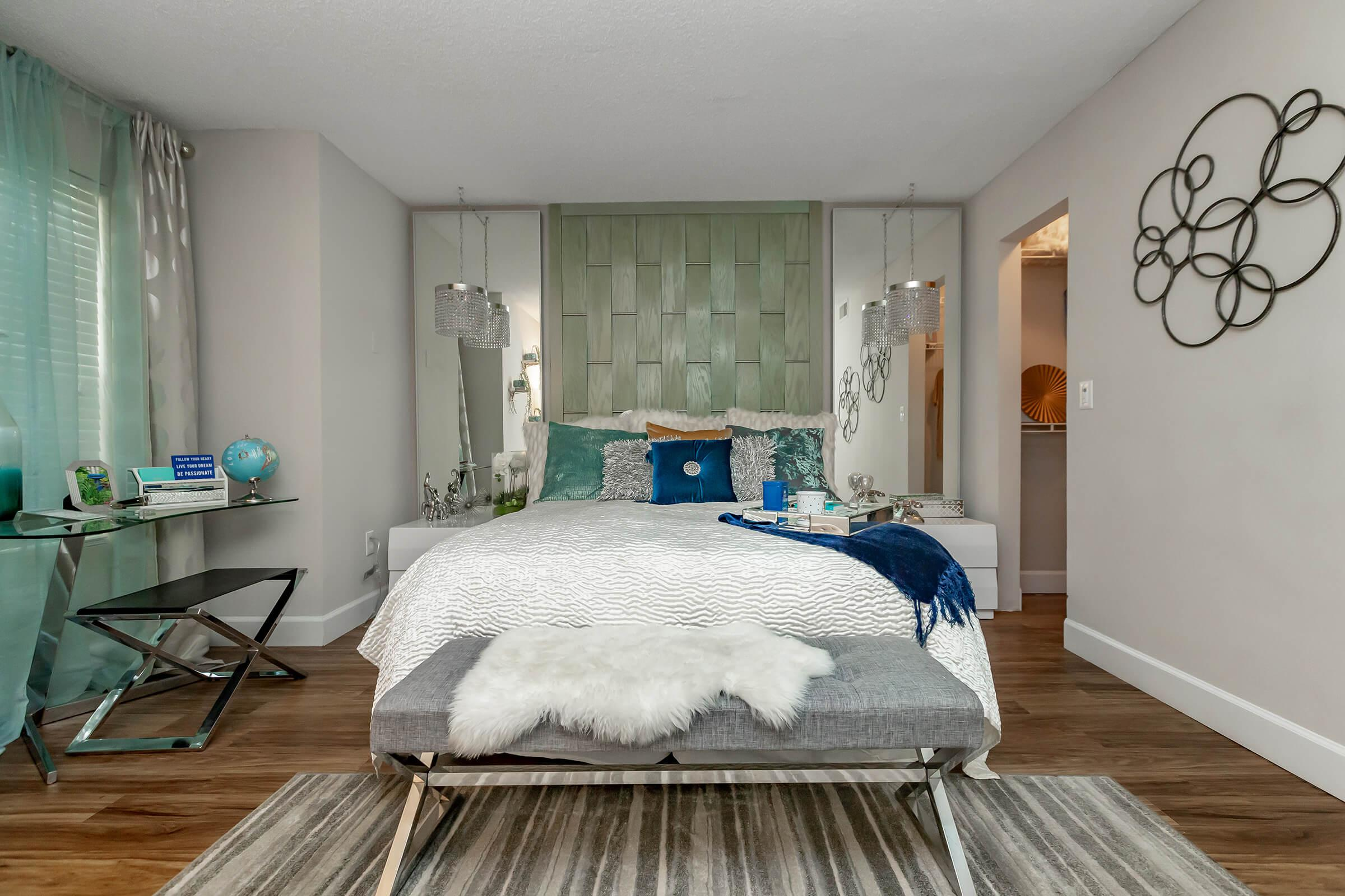 a bedroom with a wooden table