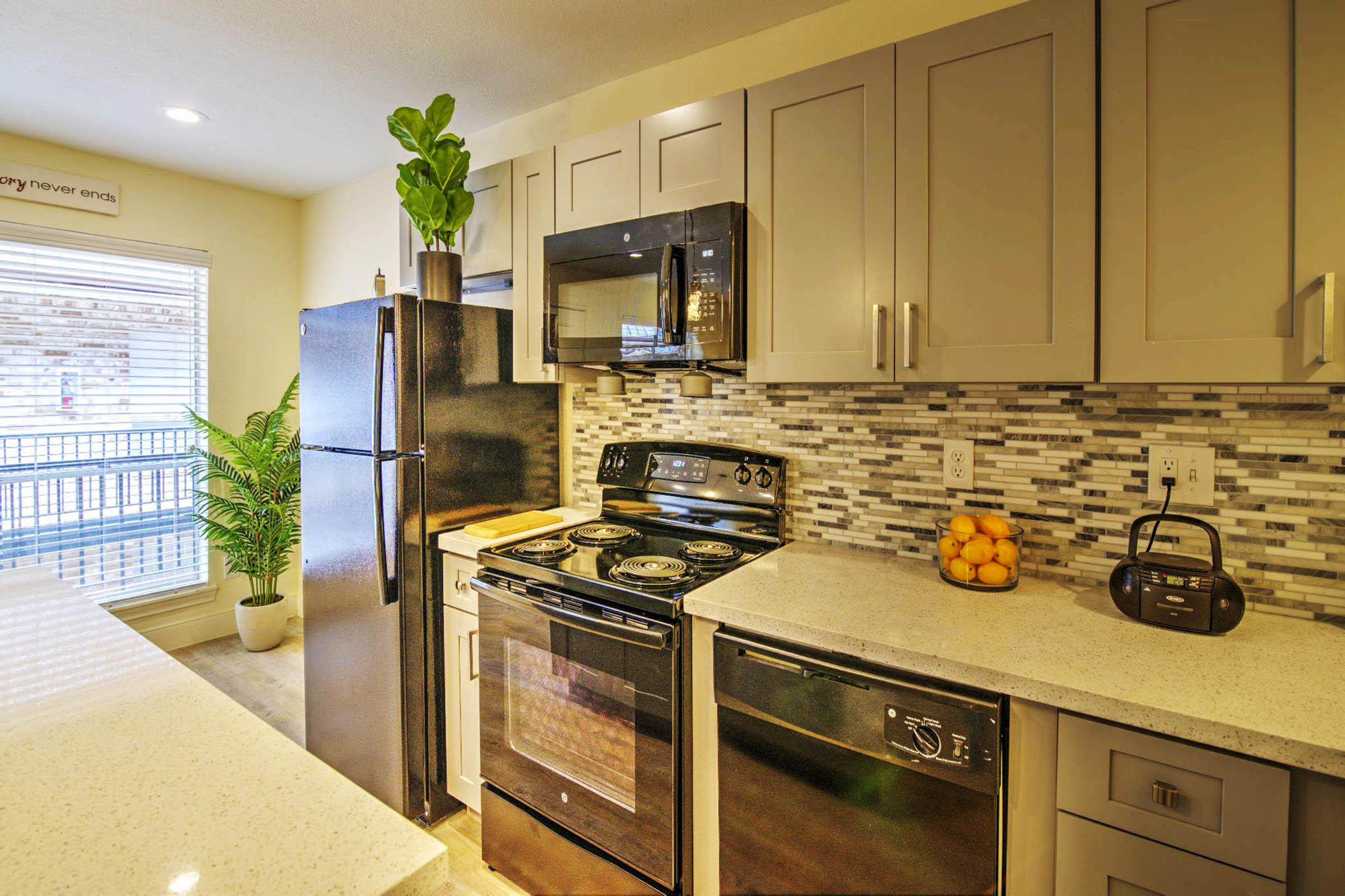 one bedroom granite counter kitchen with island