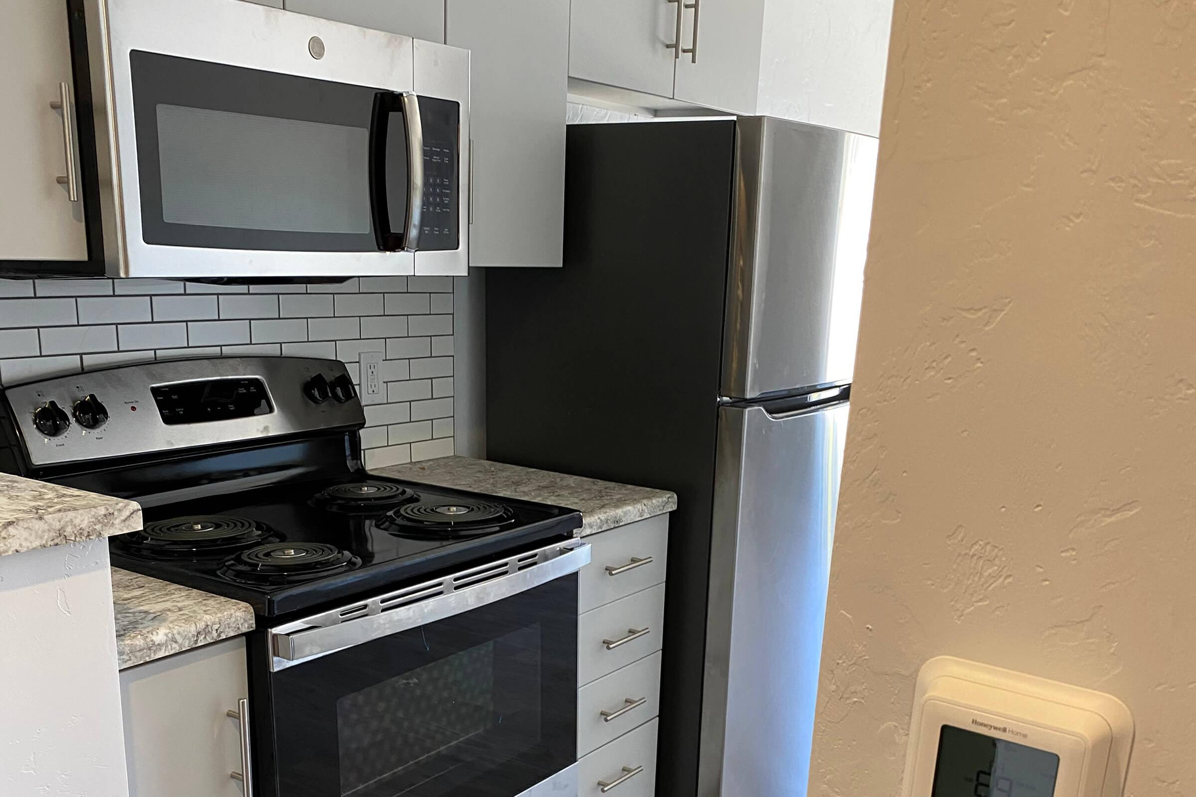 a microwave oven sitting on top of a stove