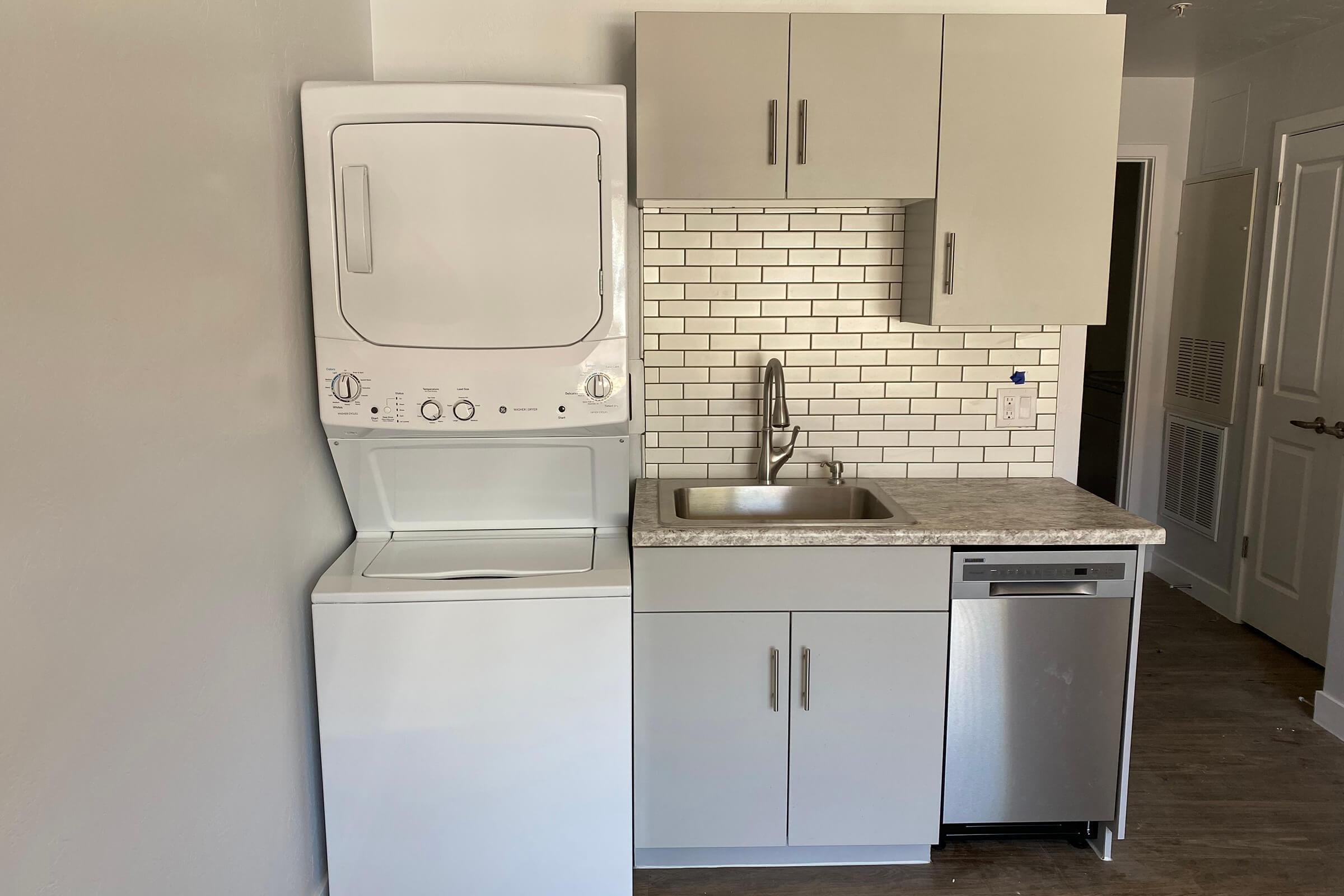 a stove top oven sitting inside of a refrigerator