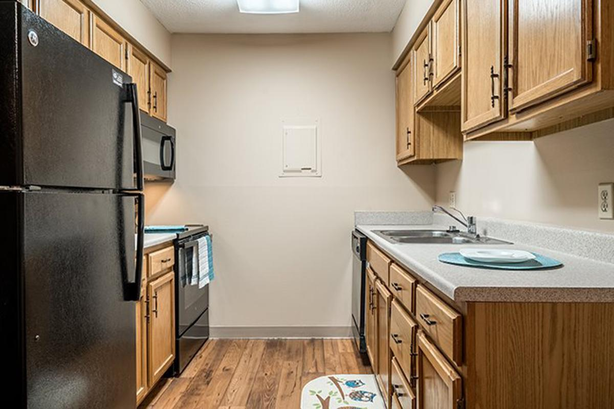 Interiors- Galley style kitchens at Oakwood Trail Apartments in Omaha Nebraska.jpg