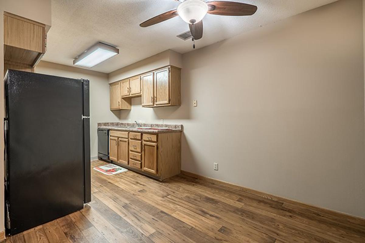 Interiors- Hardwood-style flooring inside the kitchen at Oakwood Trail Apartments in Omaha Nebraska.jpg