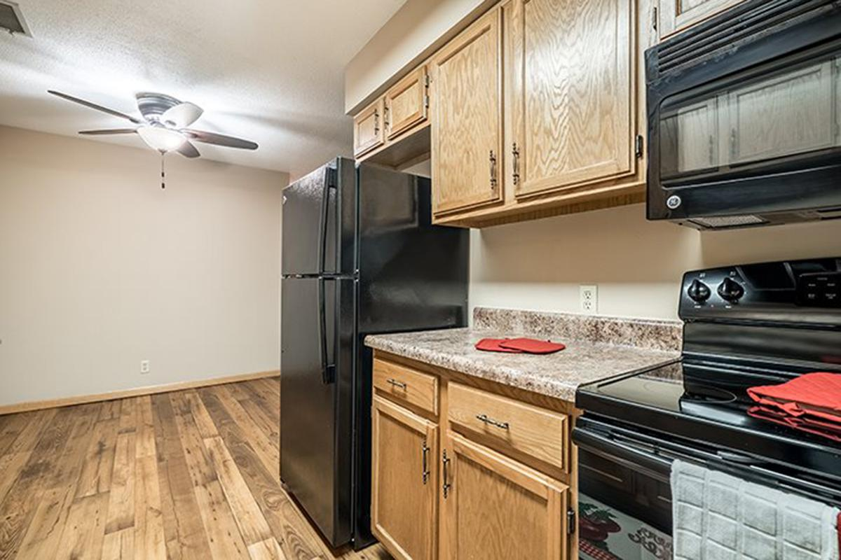 Interiors- Kitchen with dining area at Oakwood Trail Apartments in Omaha Nebraska.jpg