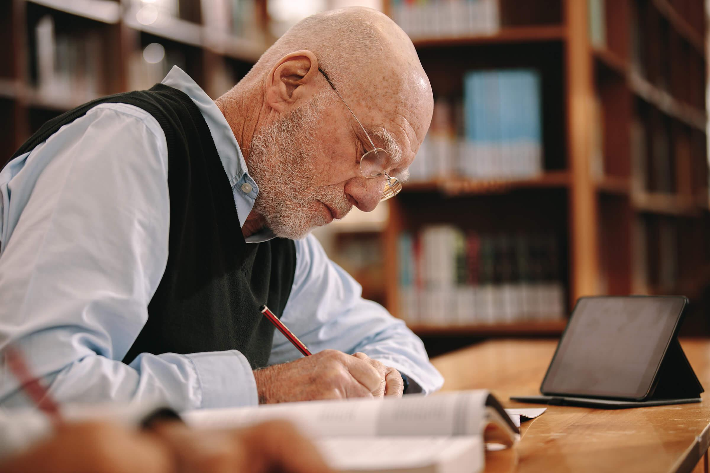 a man sitting at a table using a laptop computer