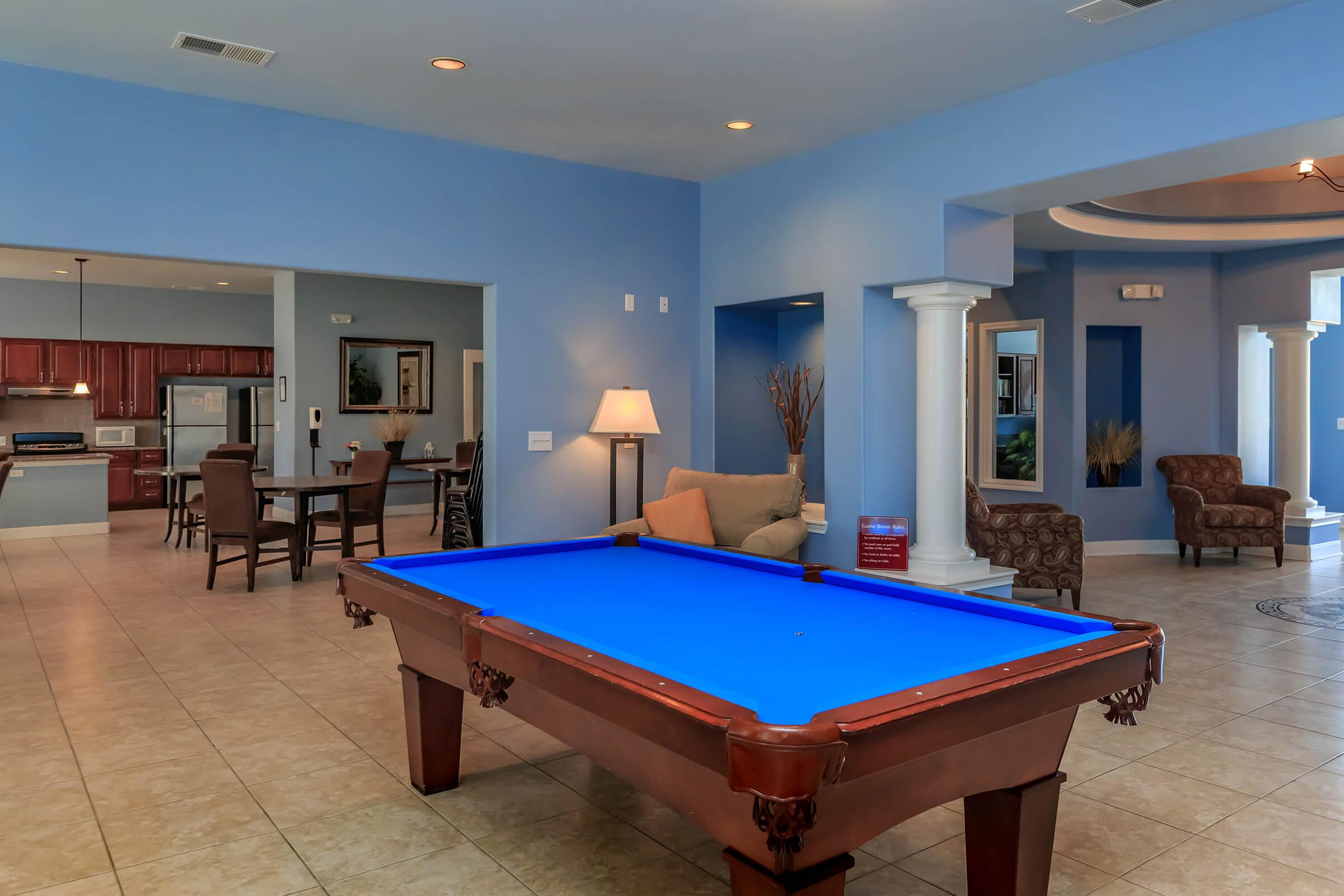 a large empty room with a pool table