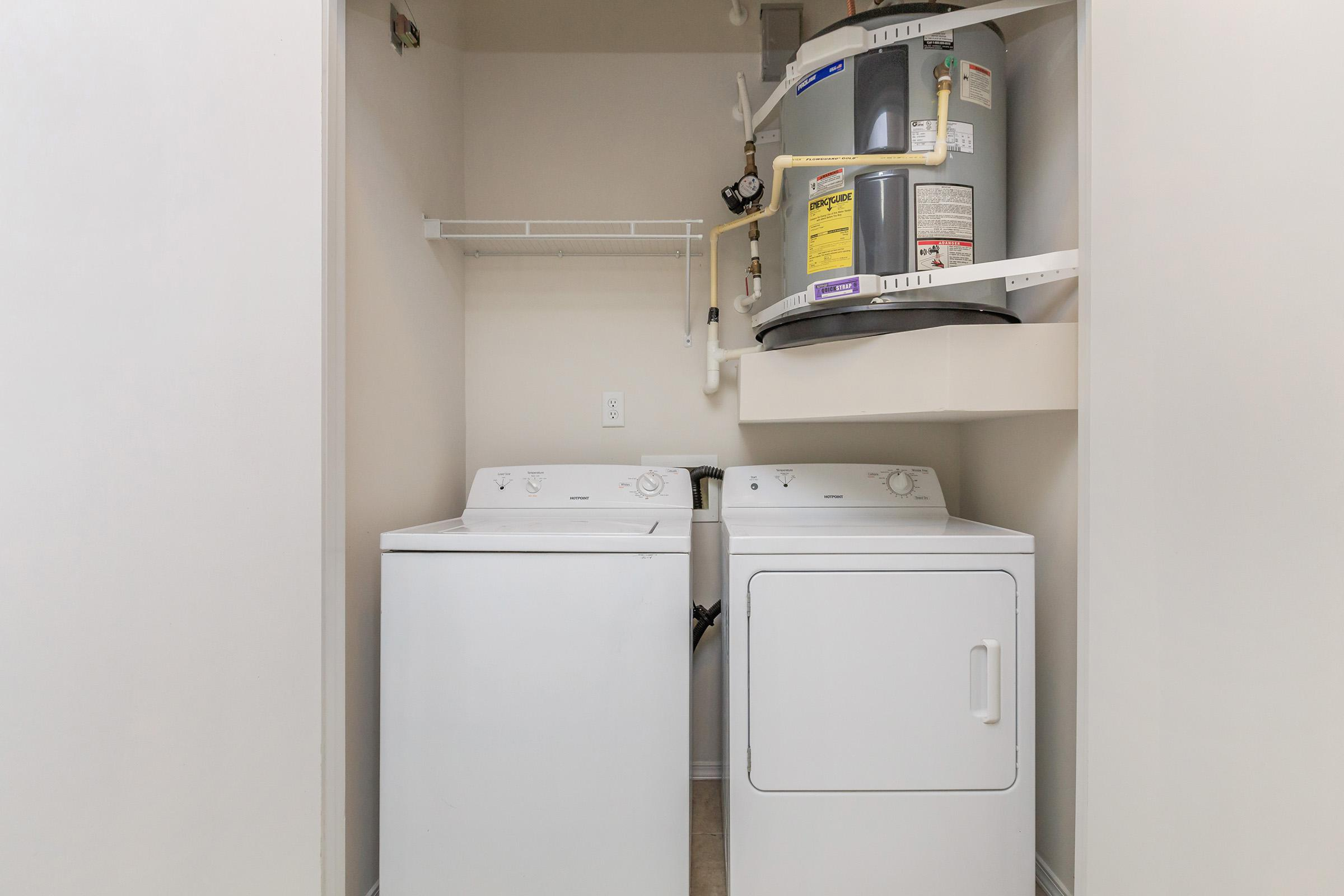 a white refrigerator freezer sitting in a room