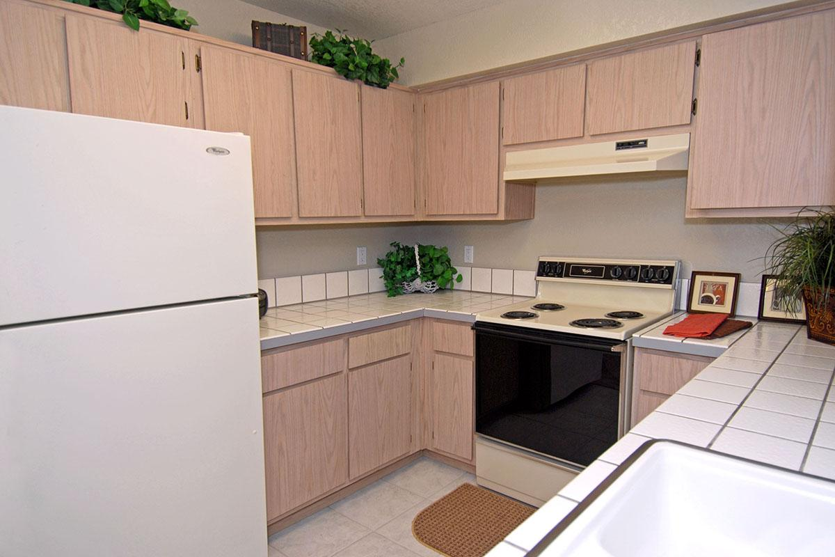 a kitchen with a refrigerator stove and microwave