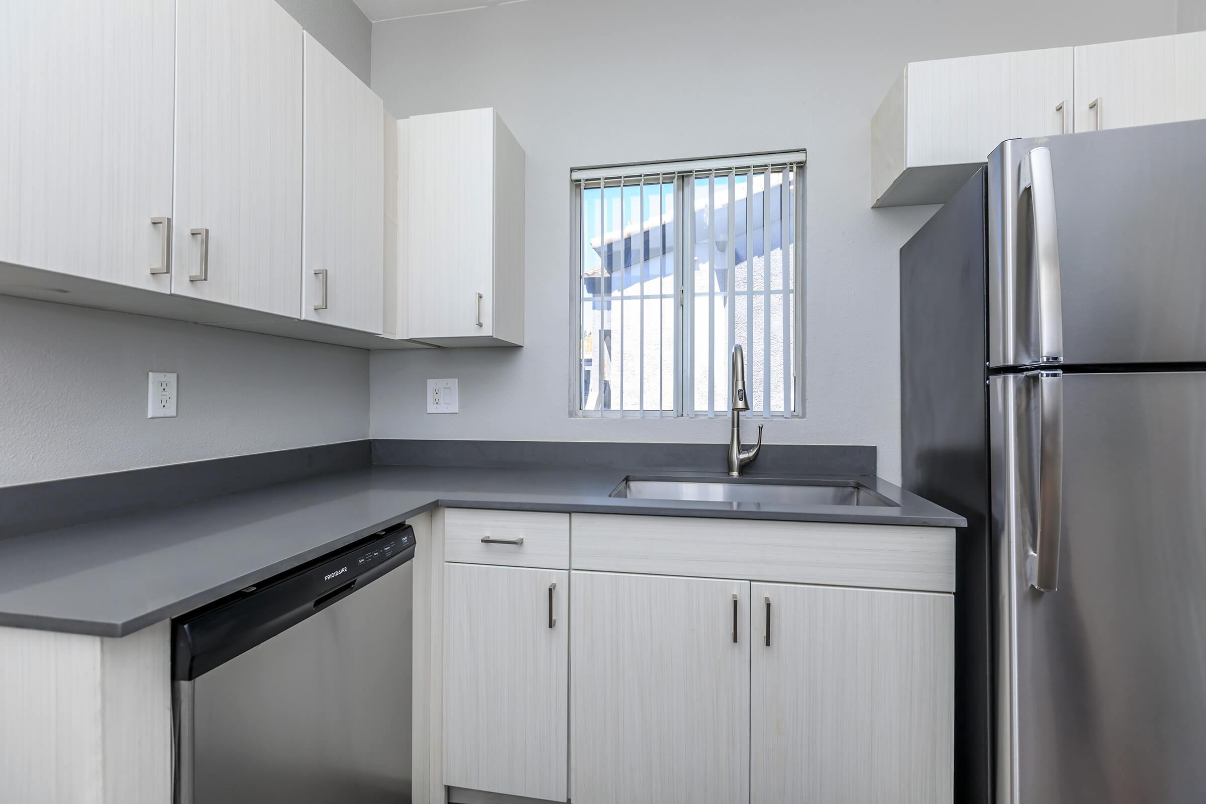 a stainless steel refrigerator in a kitchen