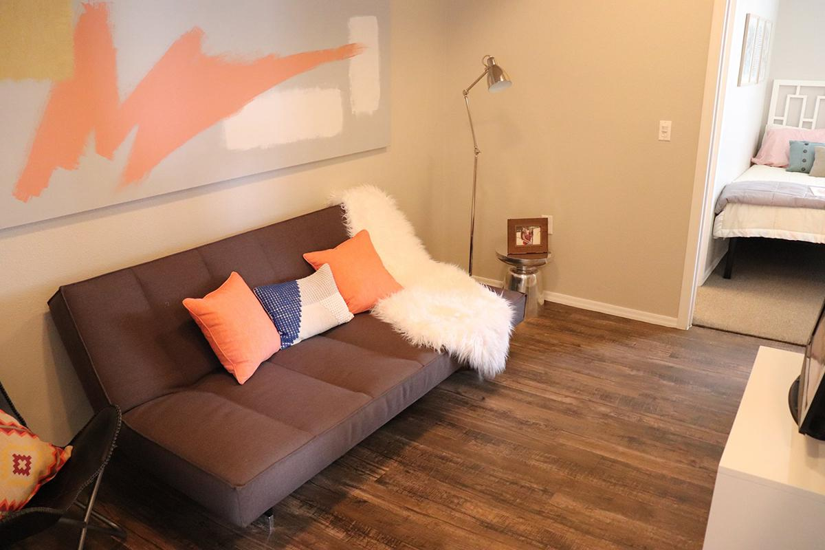 a living room with a bed and a table