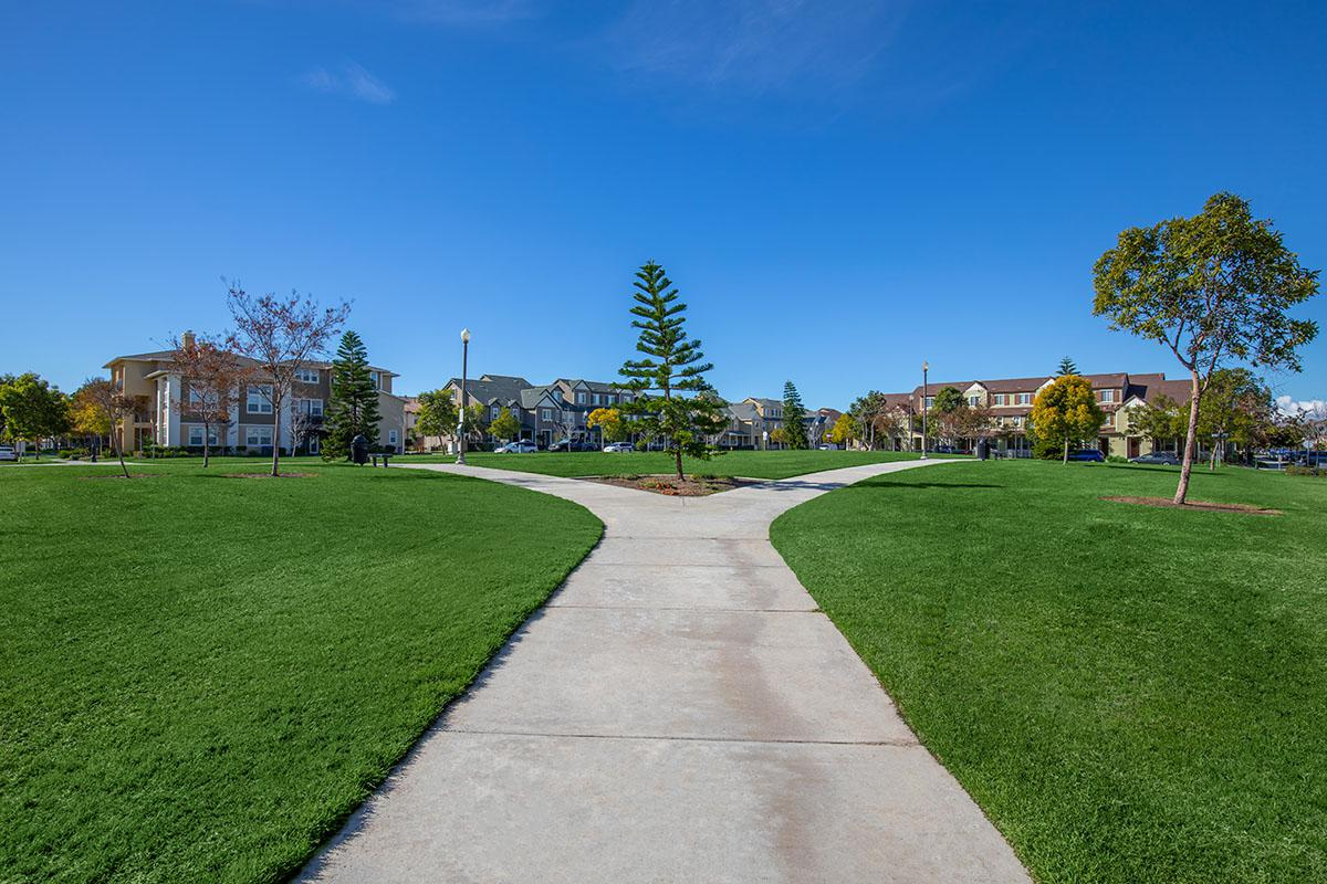 walking trail leading to townhomes in the background
