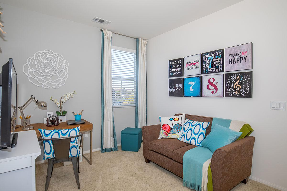 Bedroom with plush carpeting and mini blinds