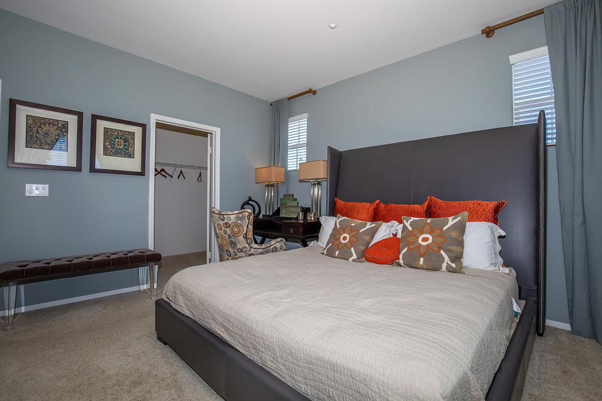 Bedrooms with plush carpeting and walk-in closets