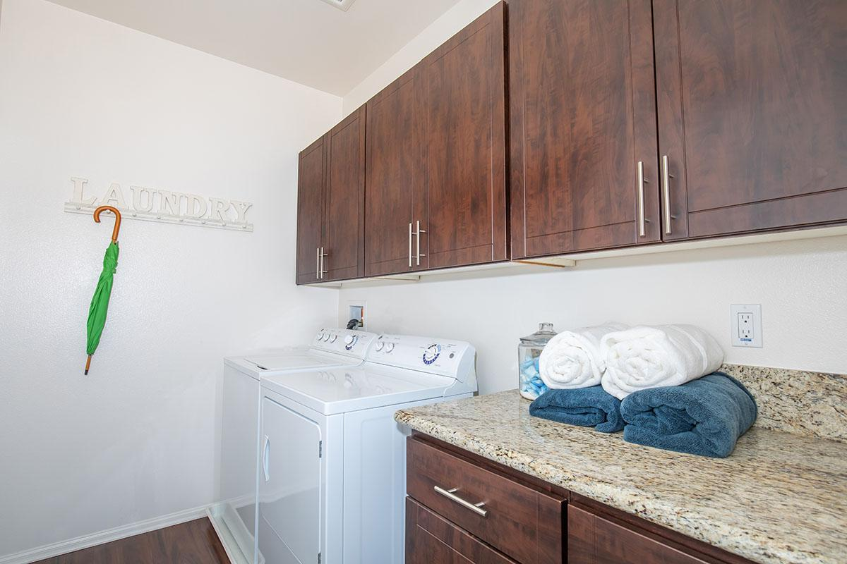 Laundry Room with washer and dryer and granite countertops
