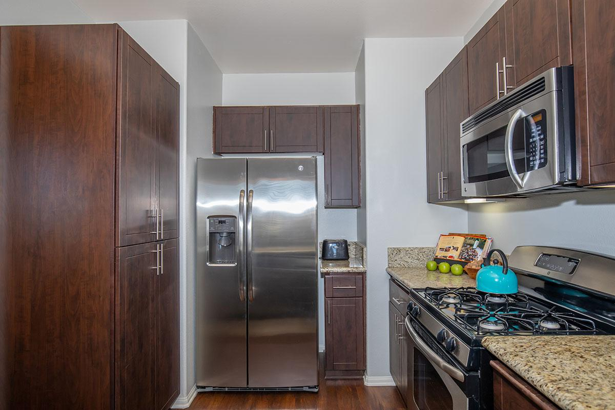 Stainless steel appliances and espresso wood cabinets
