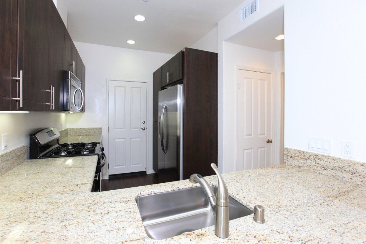 Granite Countertops with espresso wood colored cabinets