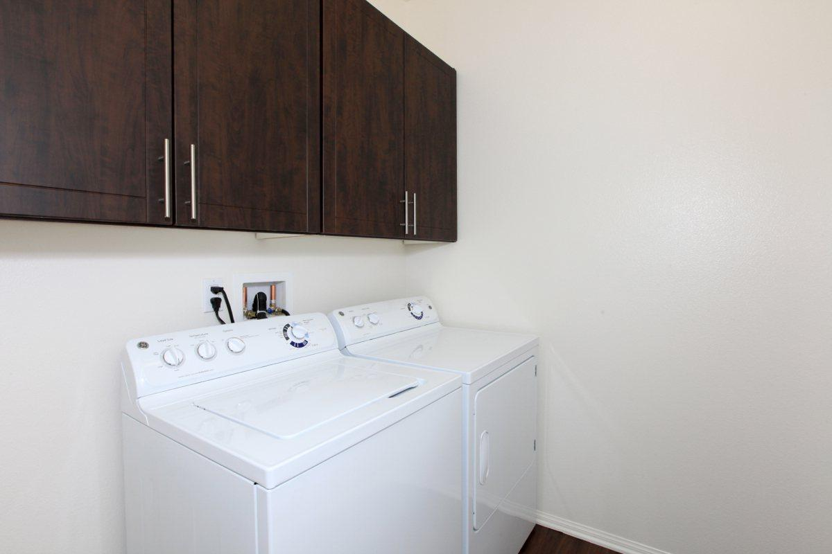 Laundry room with full-size washer and dryer