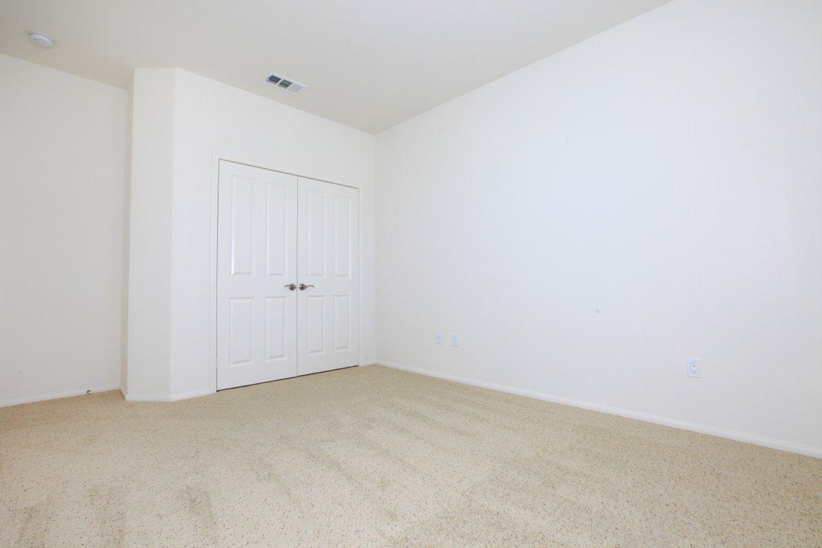Bedroom with double door closet