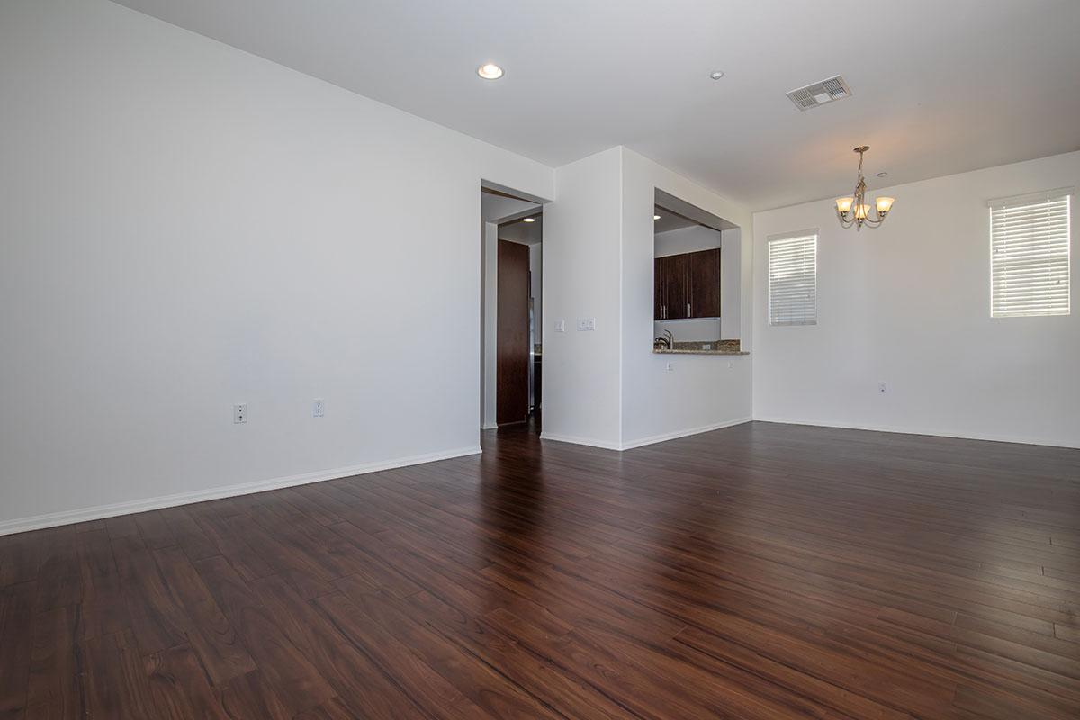 Living area with 9-foot ceilings and plank flooring
