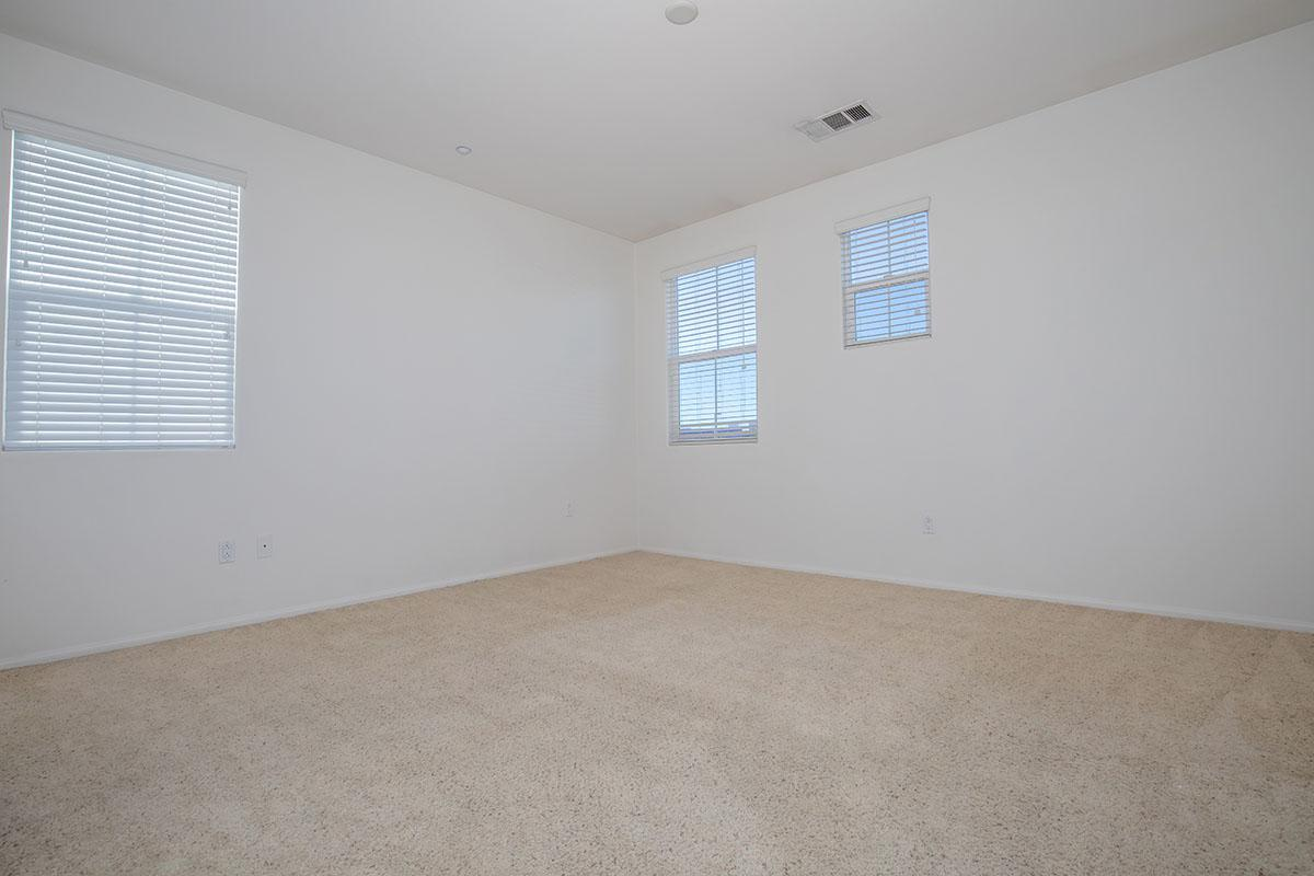 Spacious bedrooms with plush carpeting