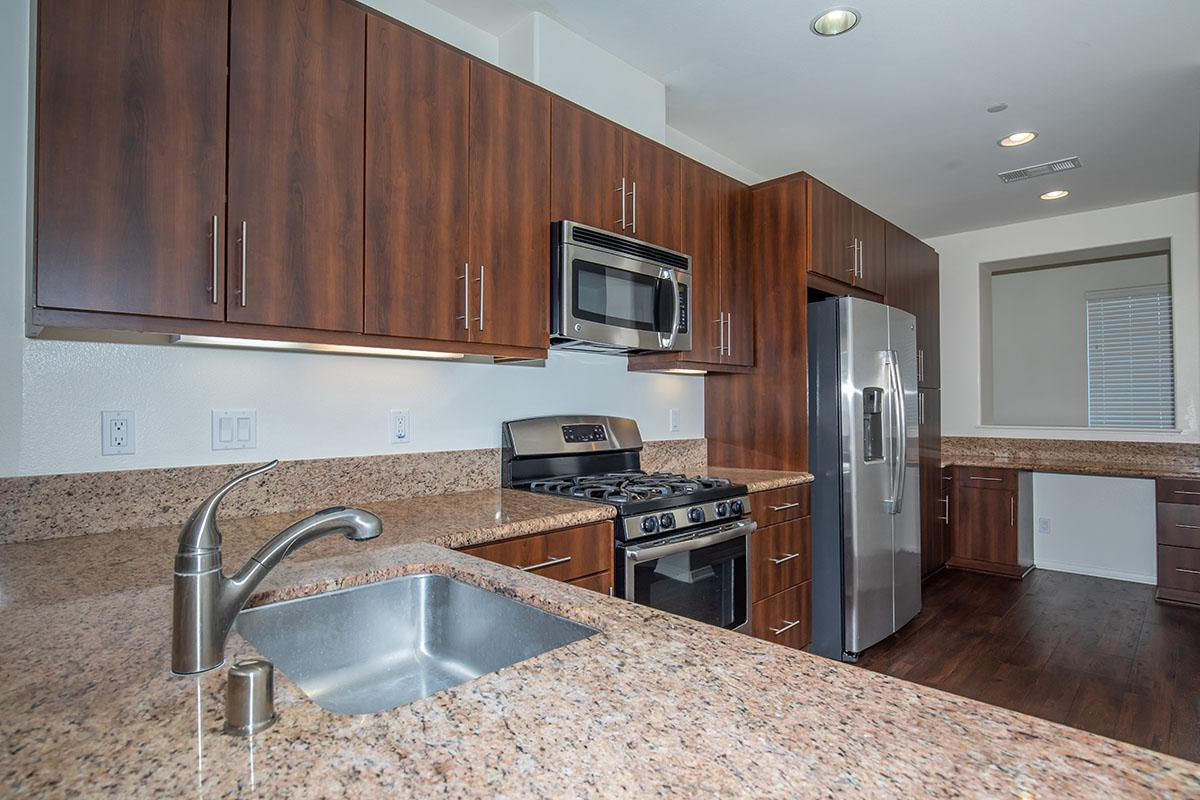 Kitchen with espresso cabinets, granite countertops, and energy star stainless appliances