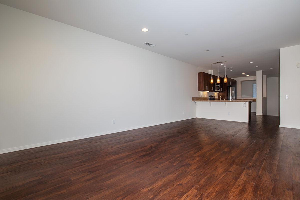 Spacious living room with breakfast bar and kitchen