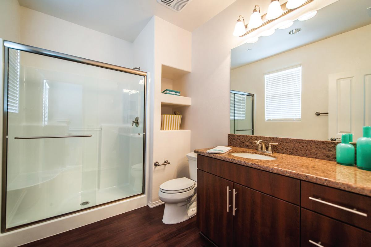 Bathroom with granite countertop and built in storage space