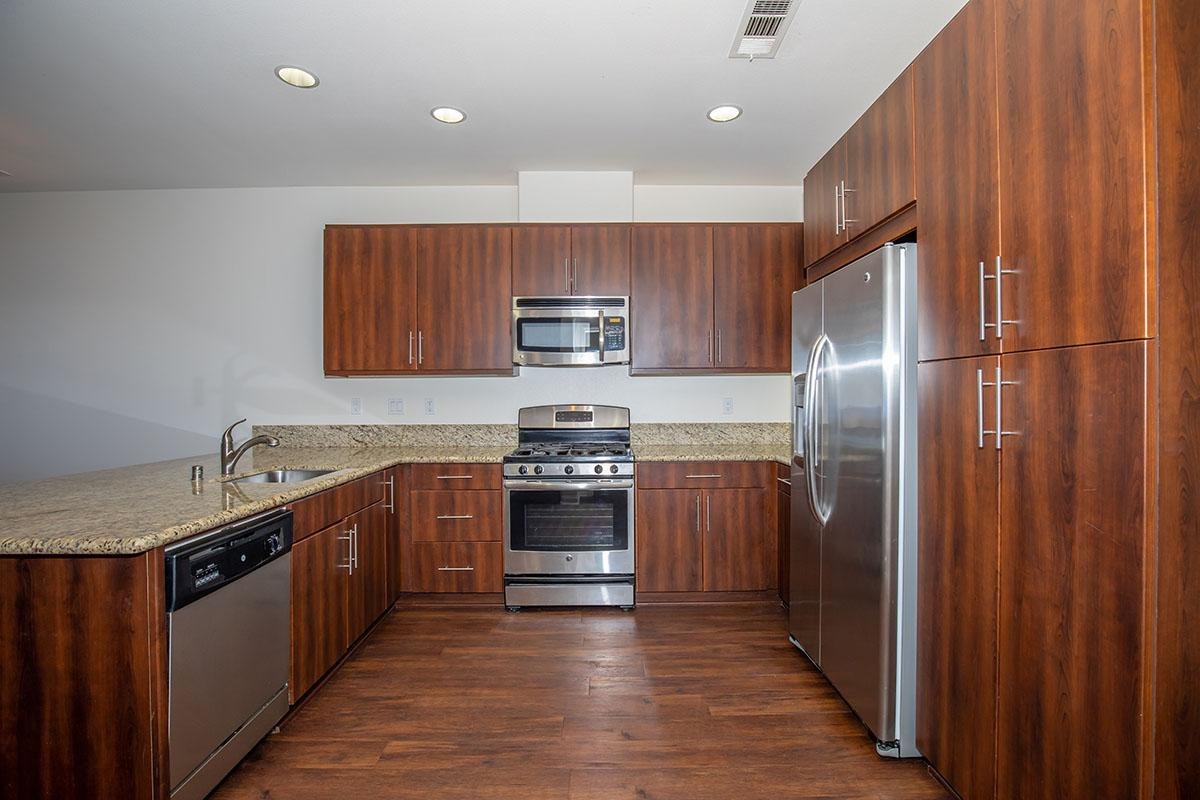Kitchen with recessed lighting, espresso cabinets, and stainless steel appliances