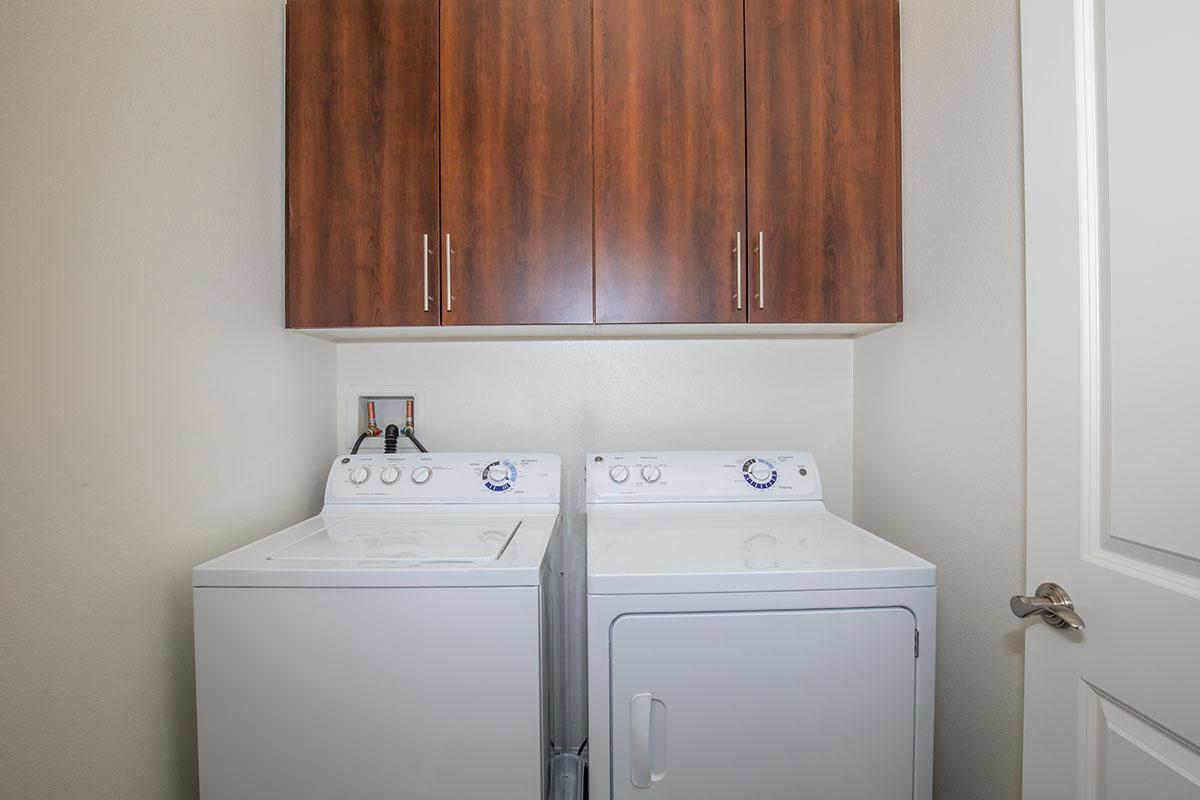 Laundry room with caninets