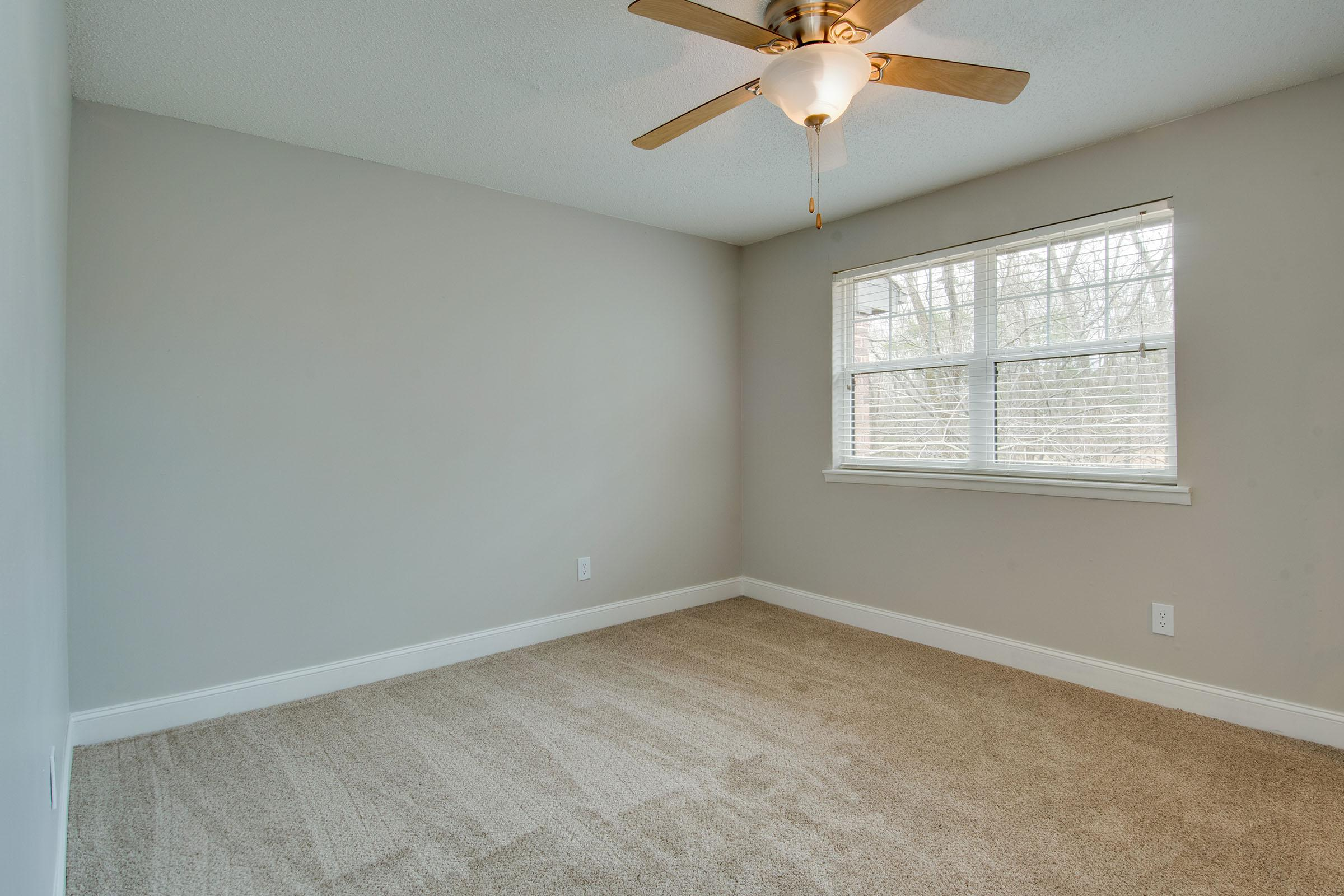 Bedroom with ceiling fans