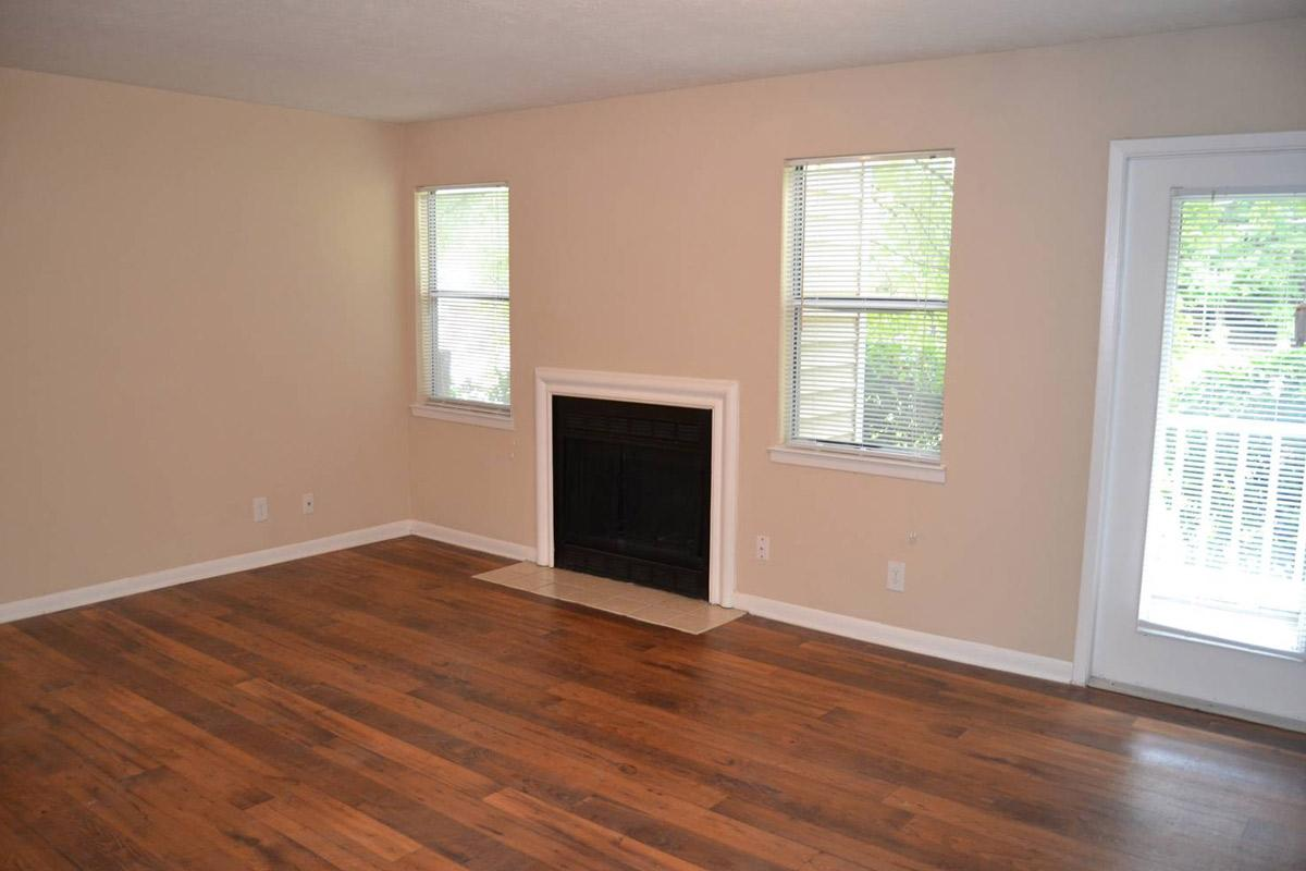 a living room with a hard wood floor