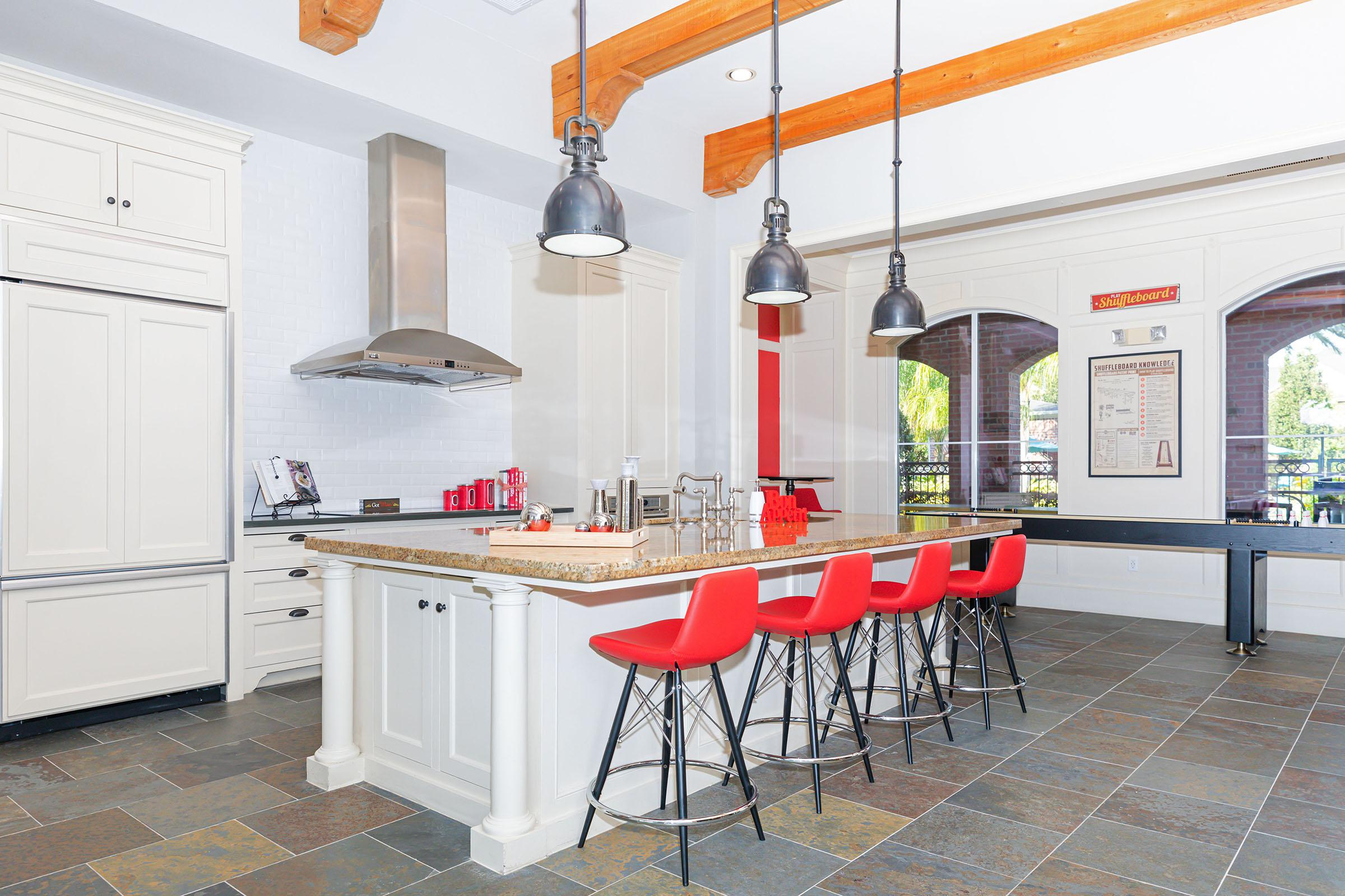 a kitchen with a table and chairs
