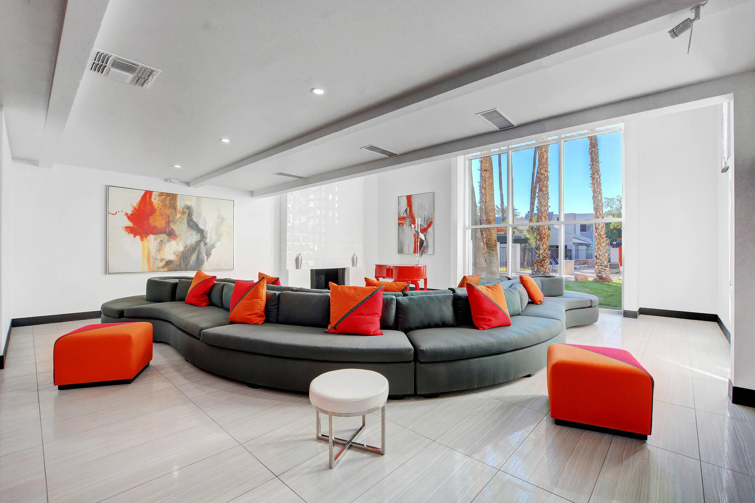 a living area with red and white furniture