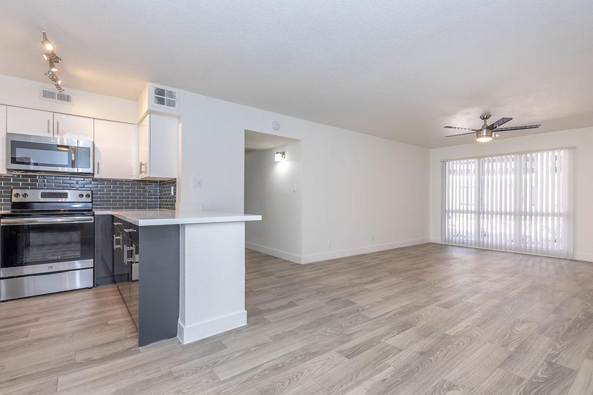an empty kitchen and living room