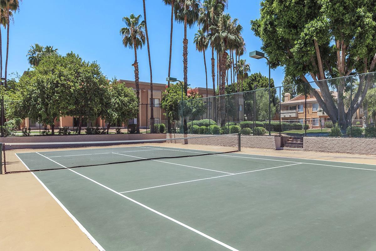 a basketball on a court with a racket