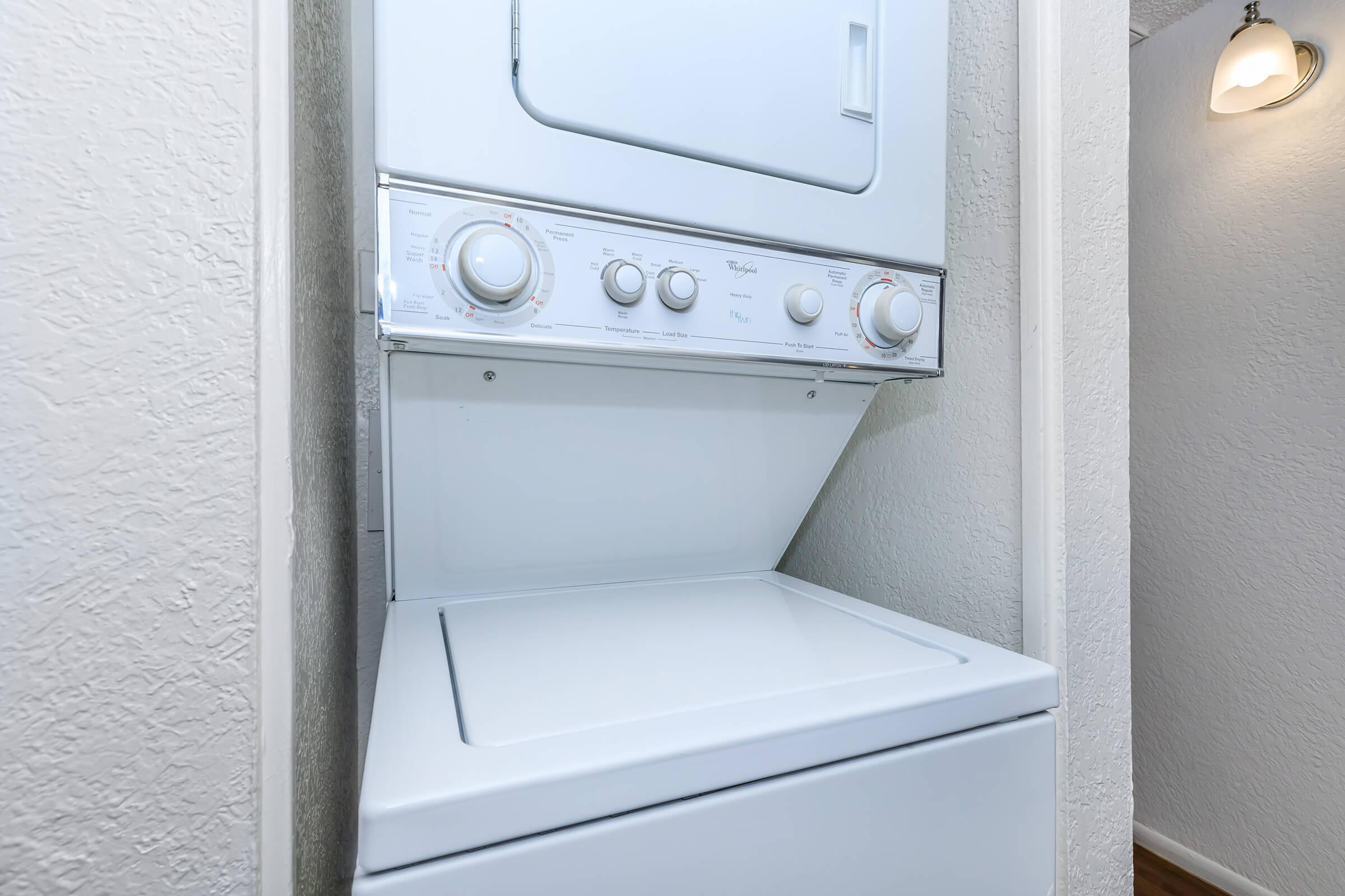 a stove top oven sitting next to a door