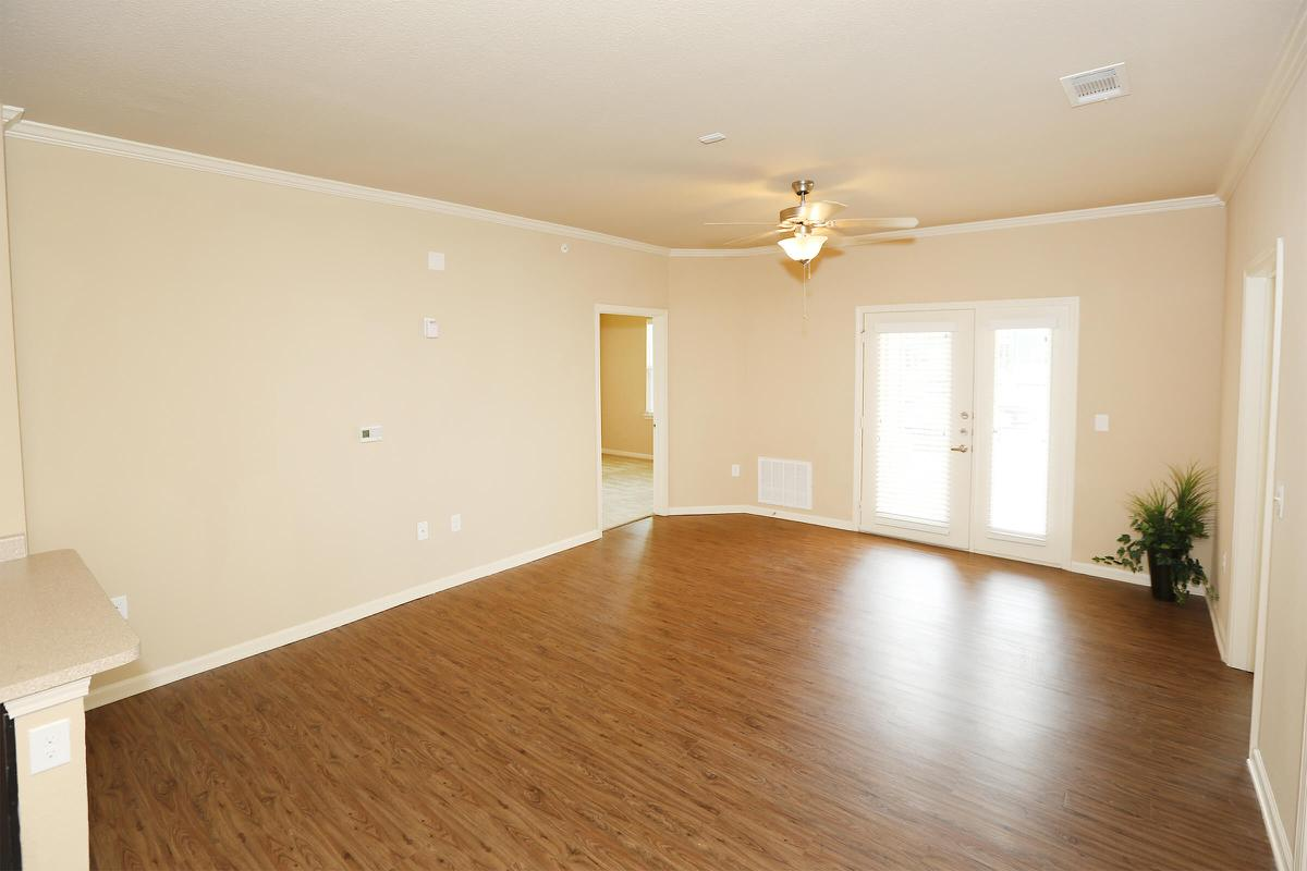 a view of a living room with a wood floor