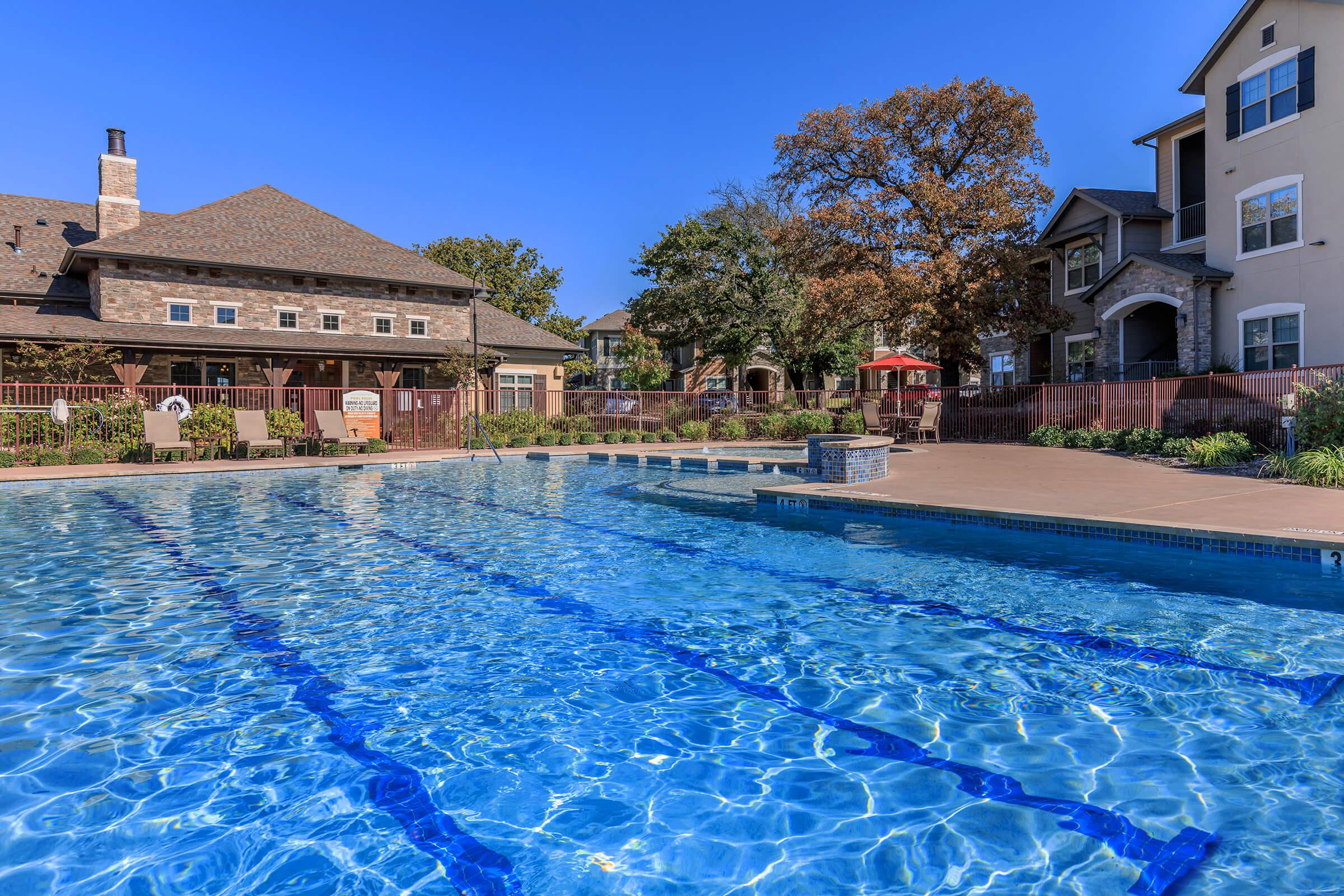 a house with a large pool of water