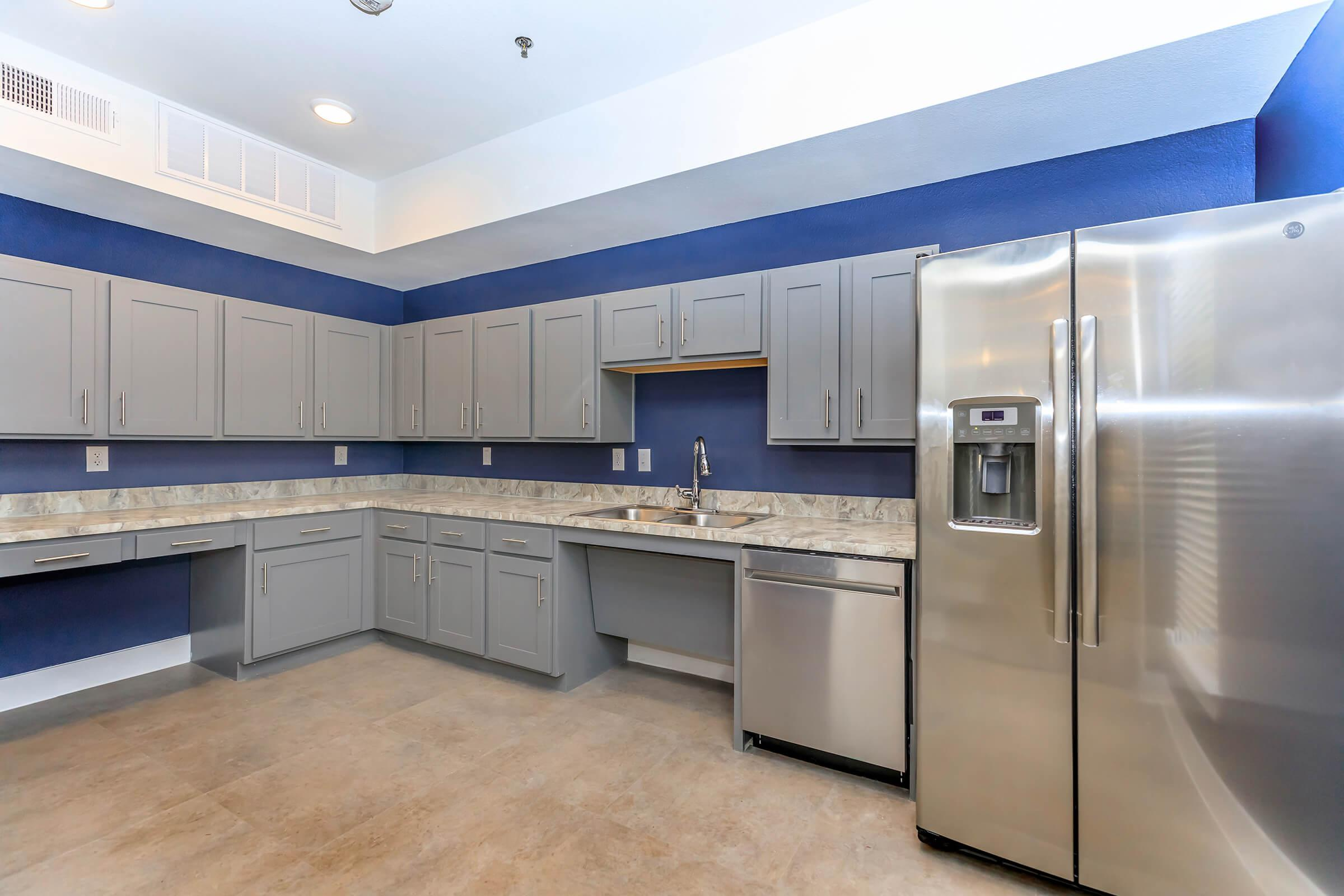 a large commercial kitchen with a blue background