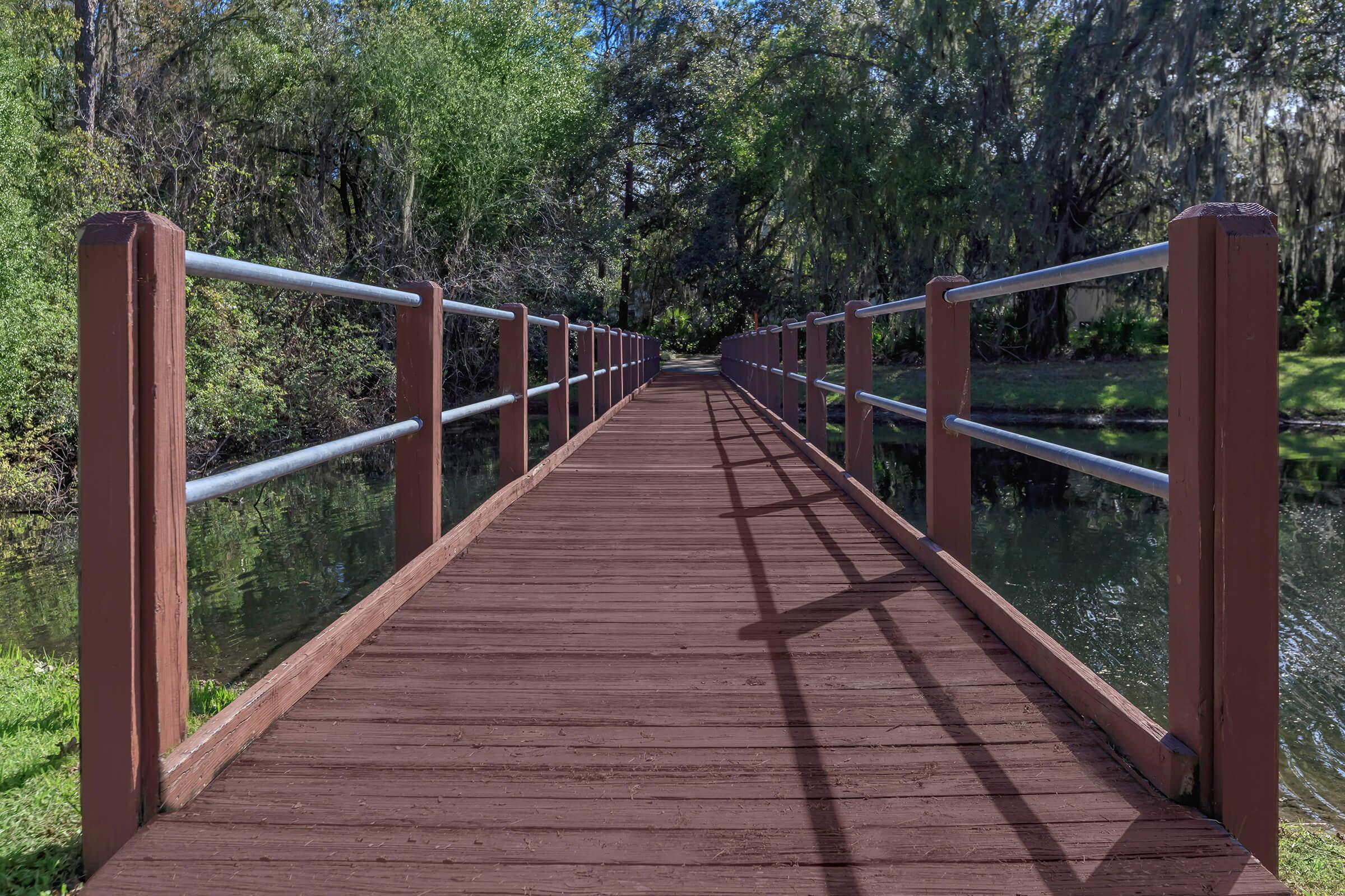a bridge going over a wooden fence