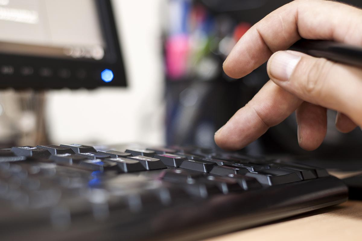a close up of a person using a mouse and keyboard